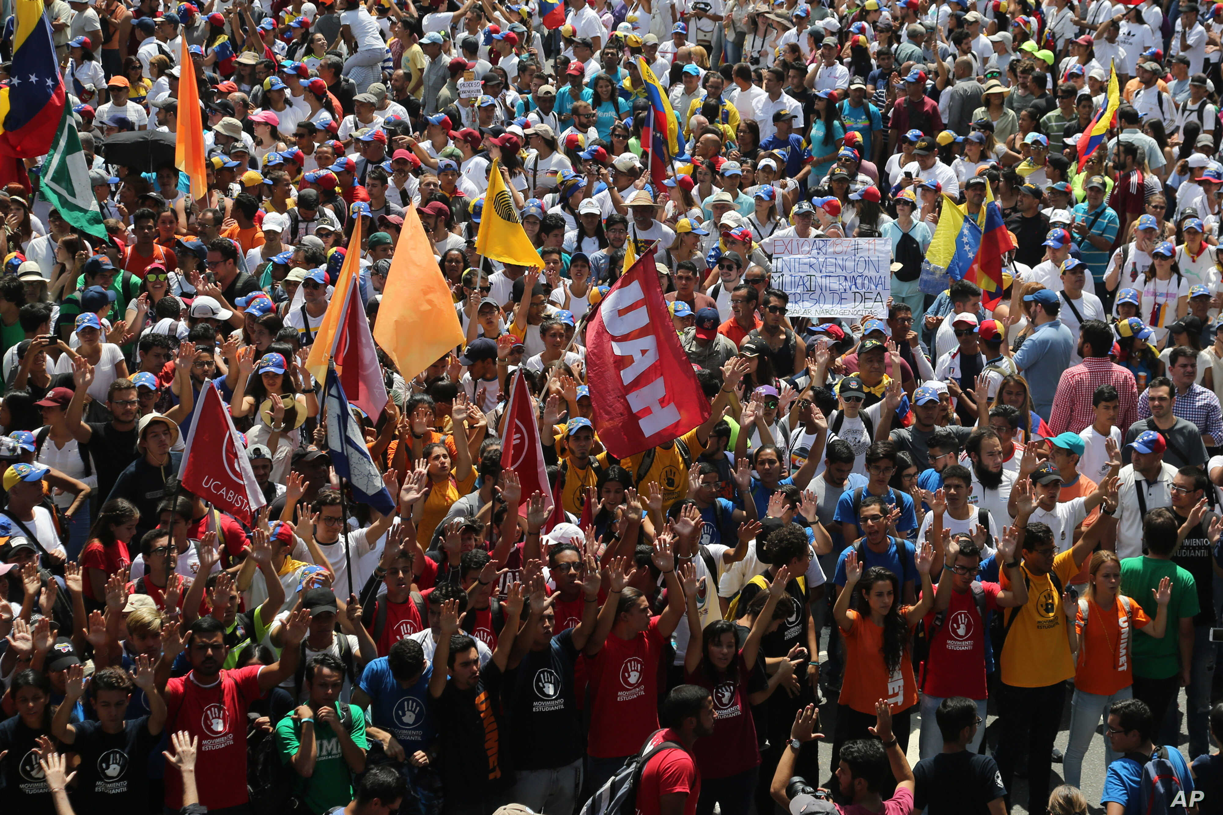 University students walk to a meeting point for a march against the government of President Nicolas Maduro, in Caracas, Venezuela, March 9, 2019.