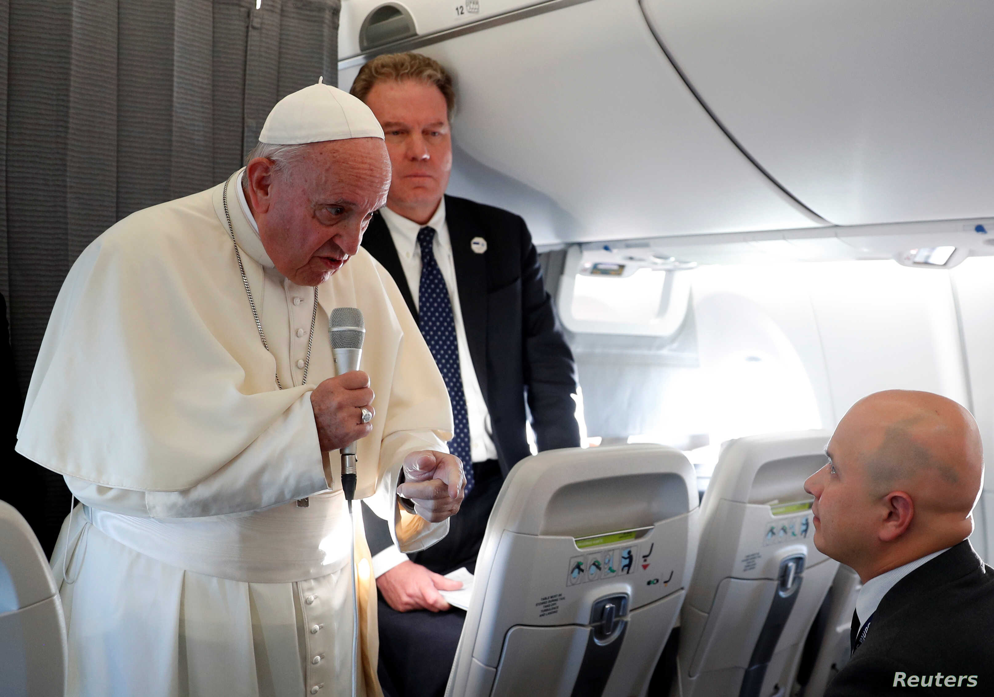 Pope Francis speaks with reporters on his flight back from Tallinn, Estonia, after the final leg of his visit to the Baltic states, Sept. 25, 2018.
