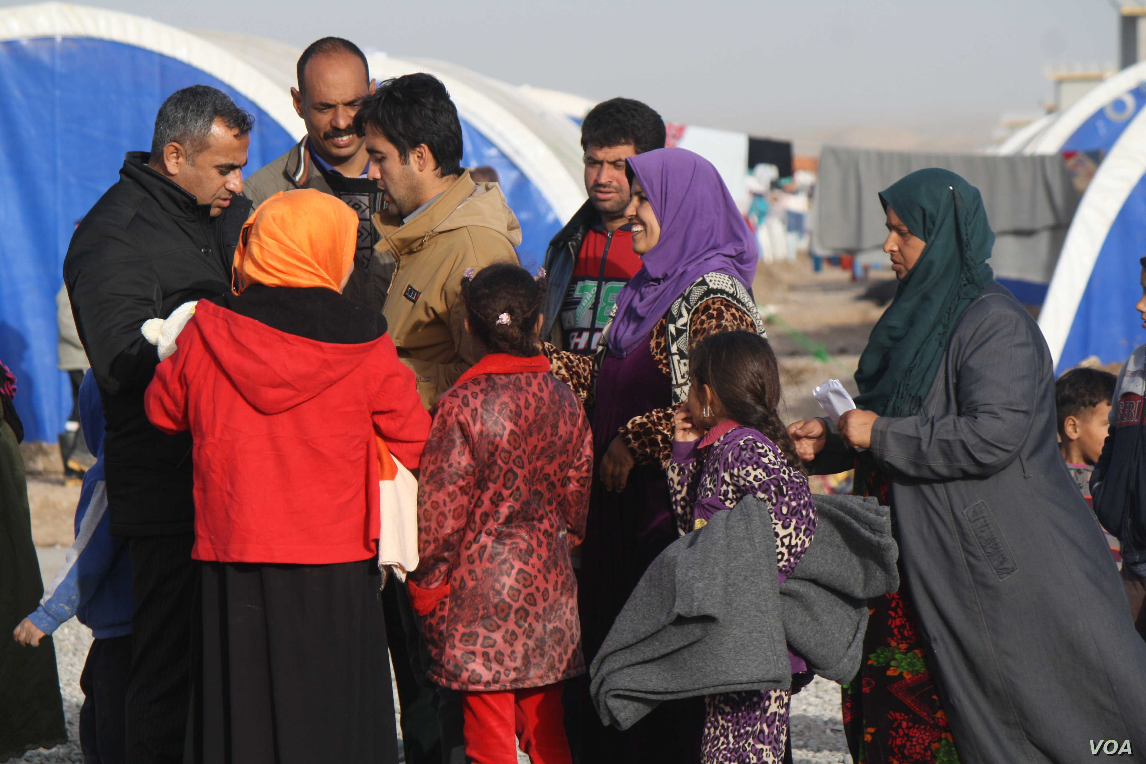 Families continue to flee IS-controlled areas in and around Mosul in favor of camps such as this one in Khazir, Kurdish Iraq, Jan. 10, 2017. The International Organization for Migration says 140,000 people have been displaced since the offensive to r...