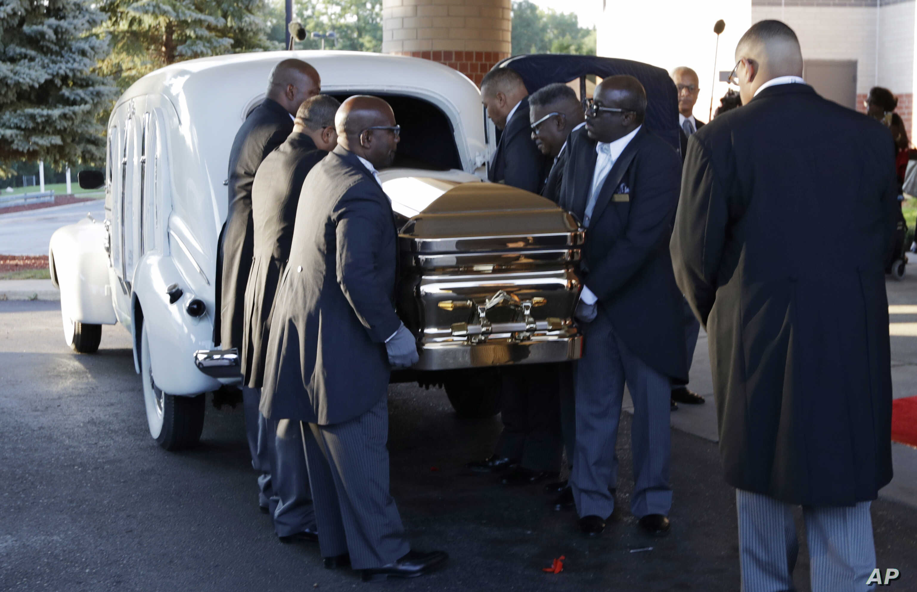 Pallbearers carry the gold casket of legendary singer Aretha Franklin after arriving at the Greater Grace Temple in Detroit, Aug. 31, 2018.
