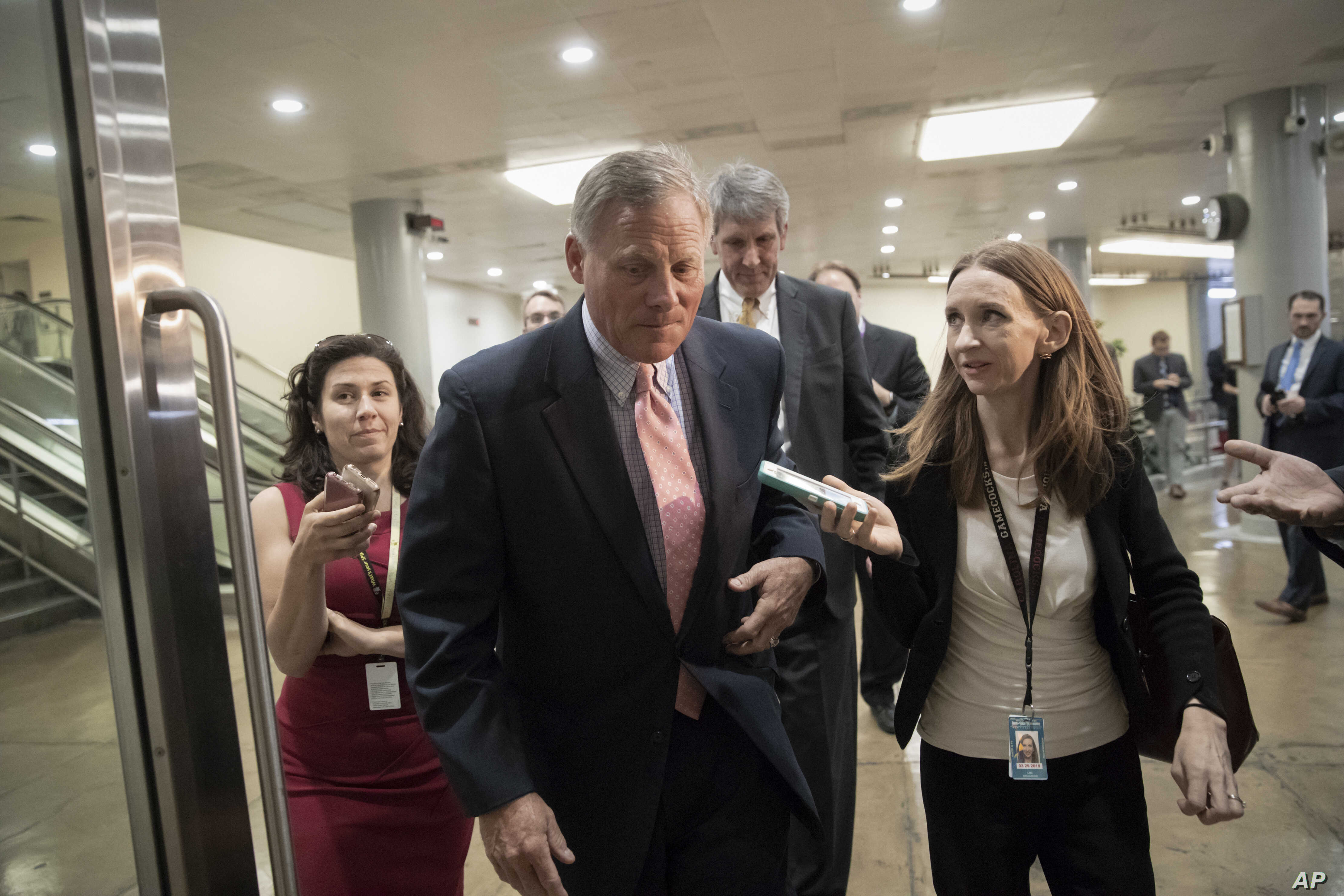 Sen. Richard Burr, R-N.C., chairman of the Senate Select Committee on Intelligence, arrives as House and Senate lawmakers from both parties gather for a classified briefing in a secure room about the federal investigation into President Donald Trump'...