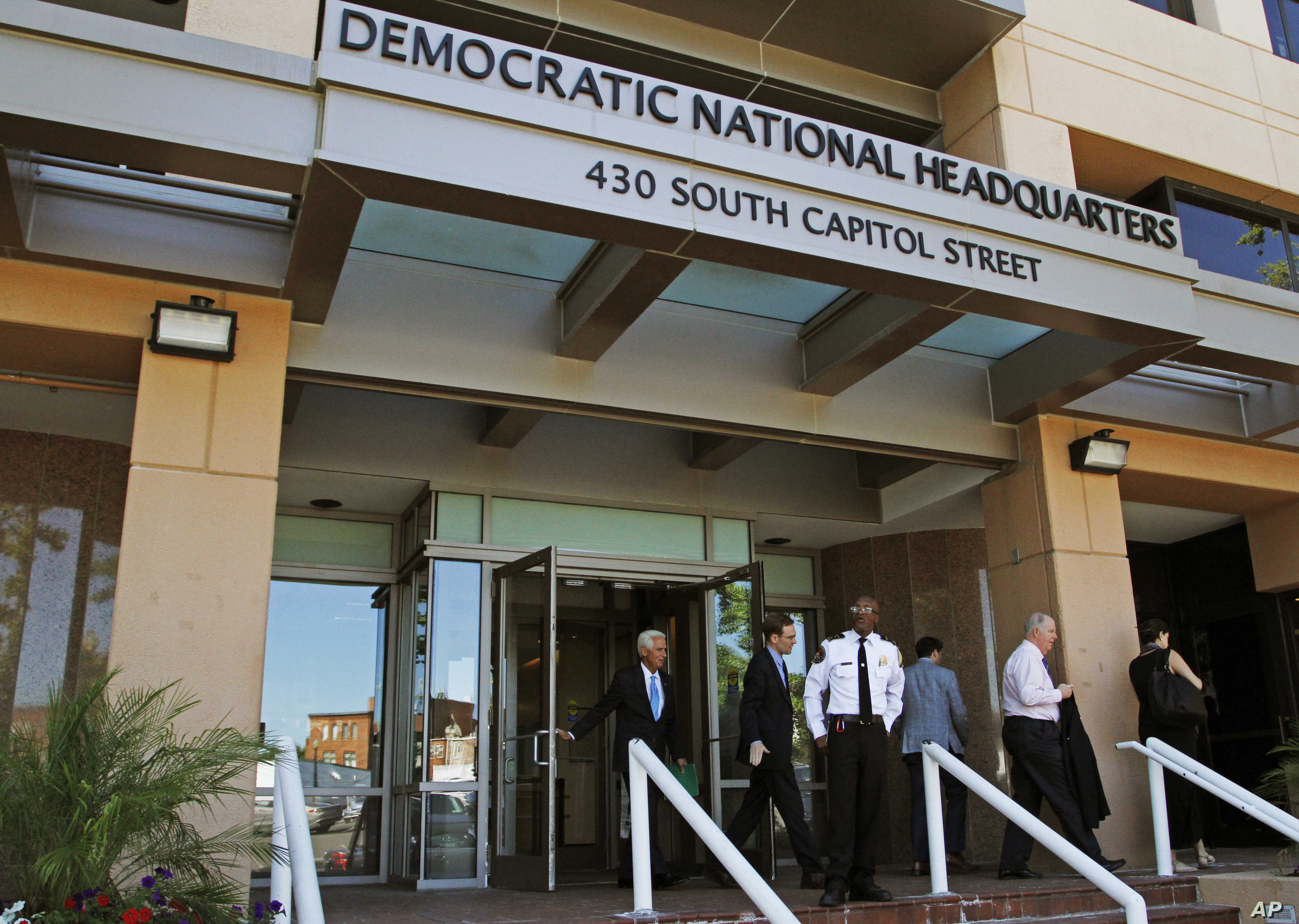 FILE - people stand outside the Democratic National Committee (DNC) headquarters in Washington.