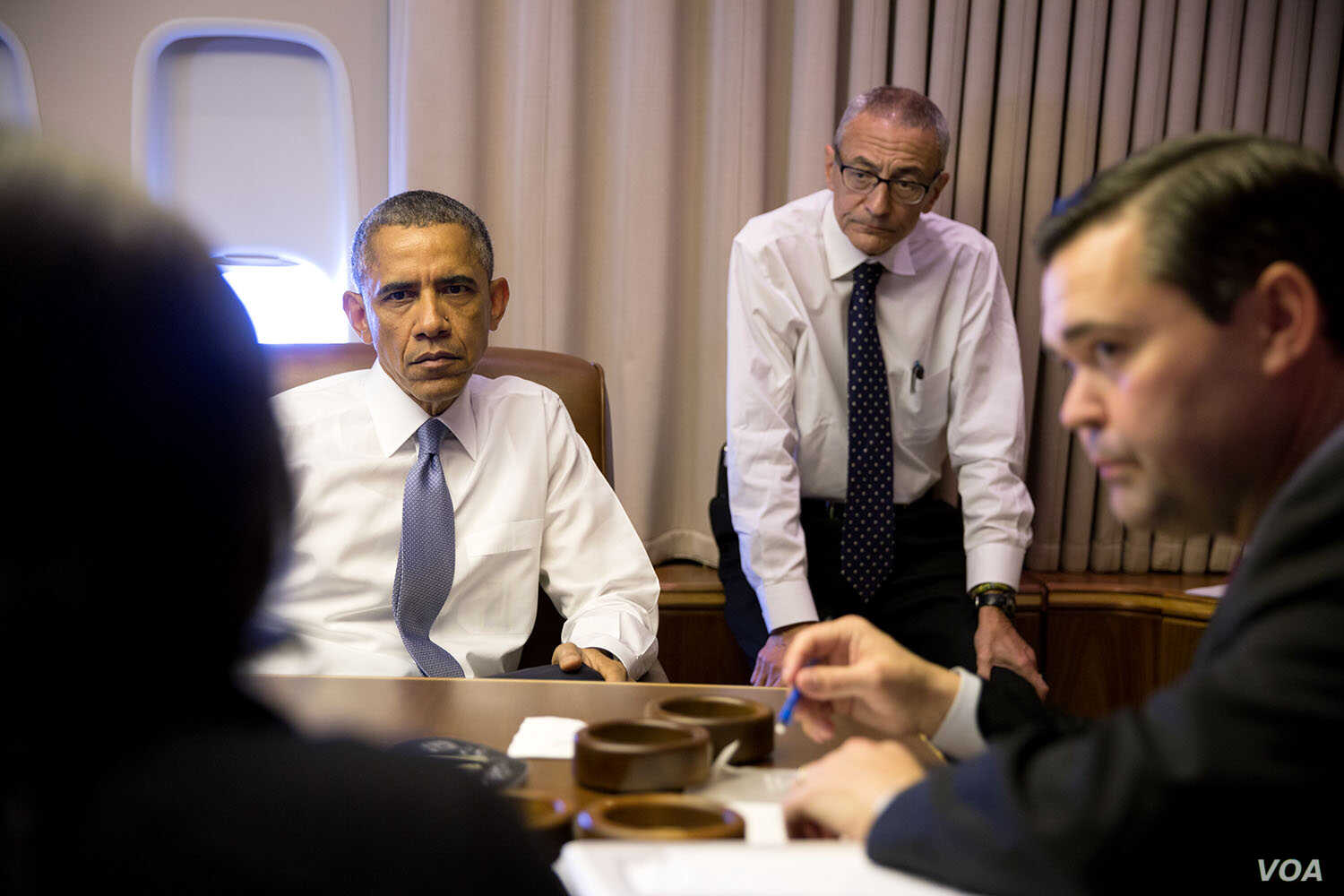 President Barack Obama holds a meeting with National Security Advisor Susan E. Rice, John Podesta, Counselor to the President and Phil Reiner, Senior Director for South Asian Affairs, aboard Air Force One en route to New Delhi, India, Jan. 25, 2015. ...