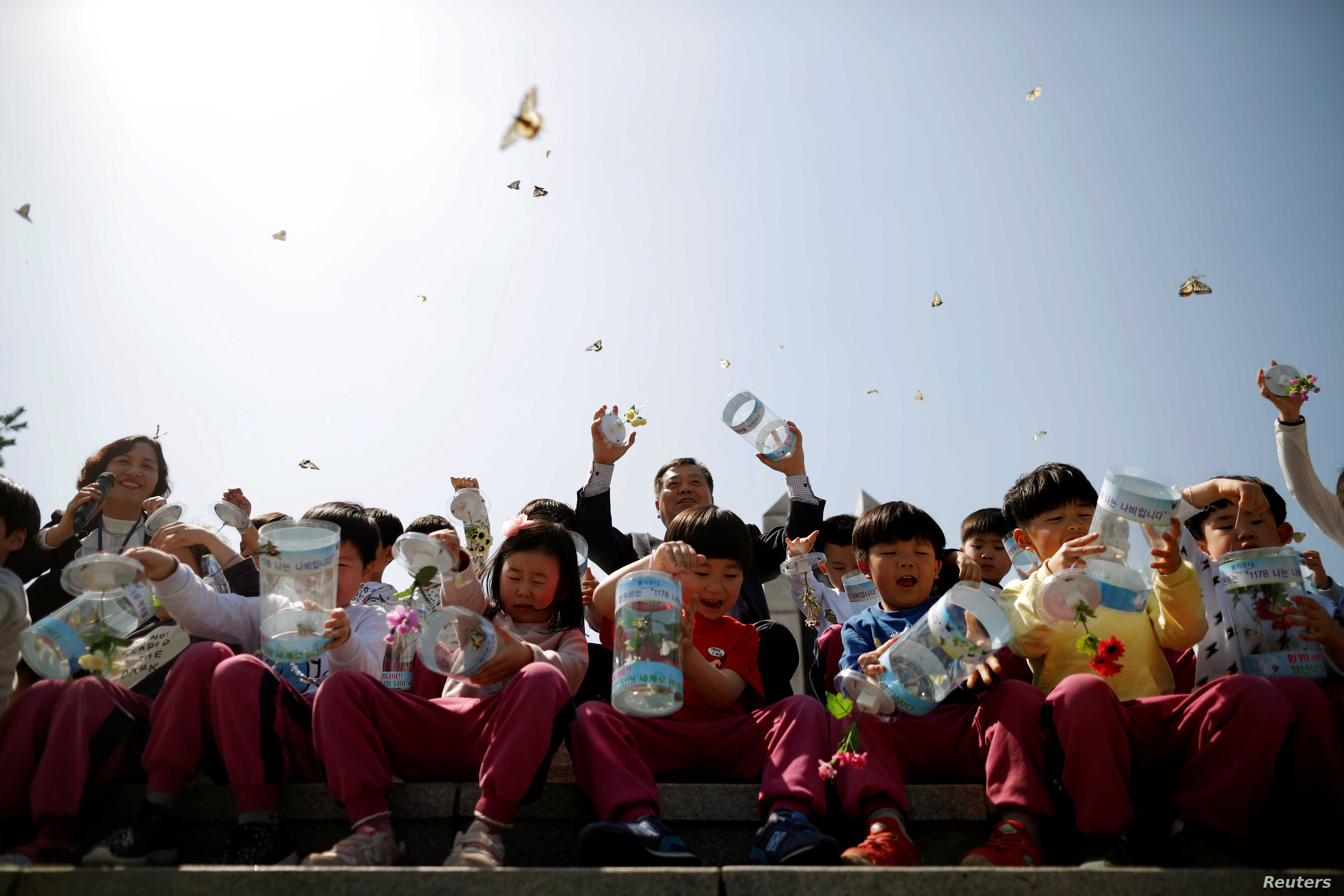 Children release butterflies during an event to wish for a successful inter-Korean summit, near the demilitarized zone separating the two Koreas in Paju, South Korea, April 25, 2018.