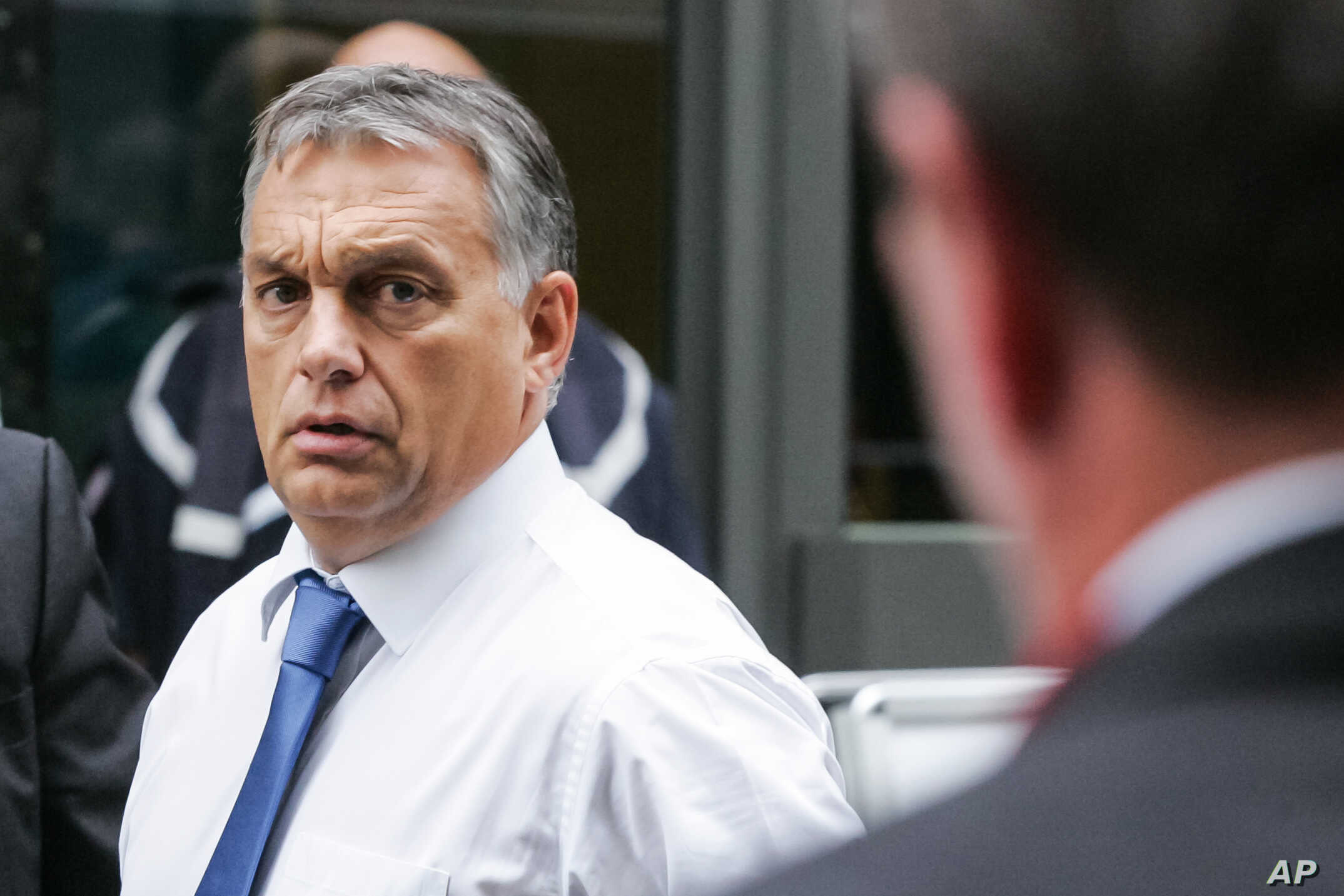 Hungarian Prime Minister Viktor Orban, right, arrives for a European Peoples  Party,  EPP meeting, ahead of an emergency EU heads of state summit on migration, in Brussels on Sept. 23, 2015.