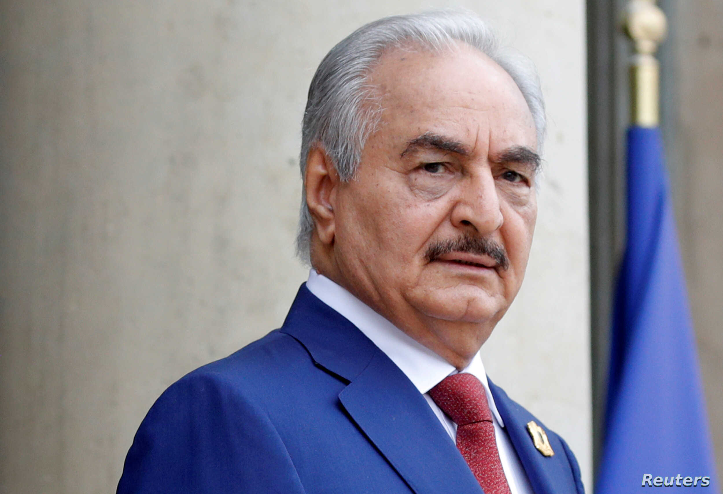 FILE PHOTO:  Khalifa Haftar, the military commander who dominates eastern Libya, arrives to attend an international conference on Libya in Paris, May 29, 2018.