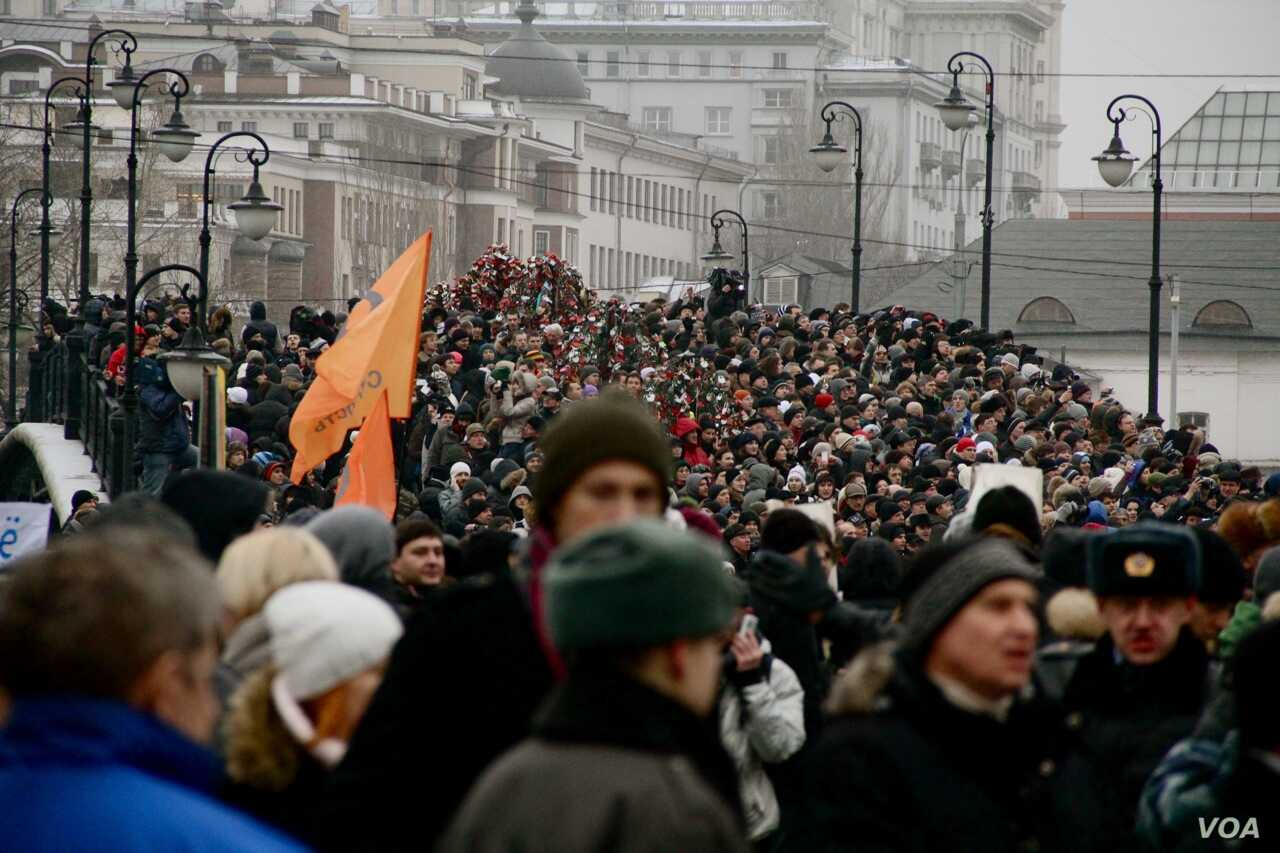 FILE - Russians rally protesting the results of parliamentary elections, in Bolotnaya Square, outside the Kremlin, Moscow, Dec. 10, 2011.