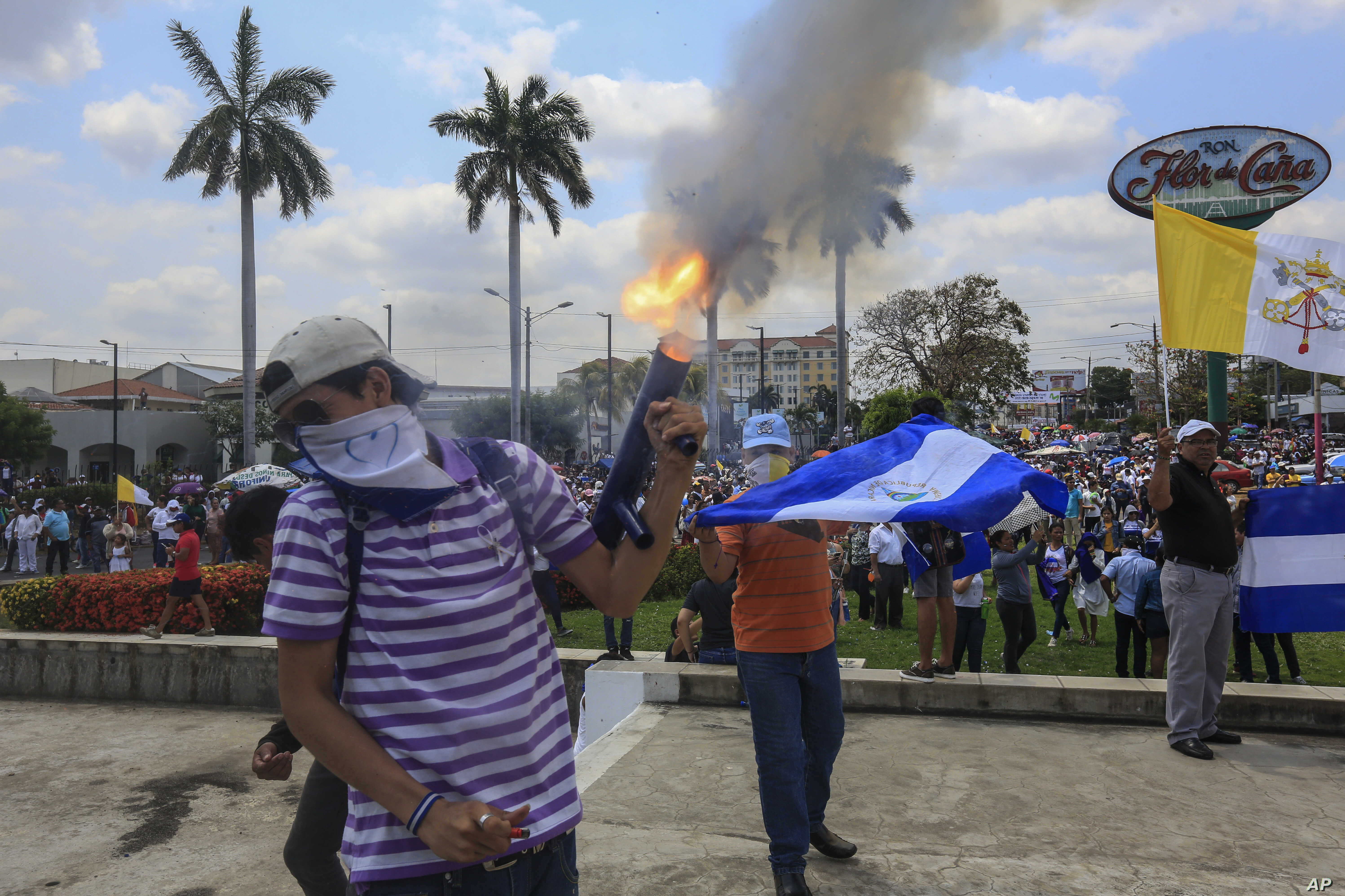 An anti-government protester fires a homemade mortar on the sidelines of a Stations of the Cross procession on Good Friday in Managua, Nicaragua, April 19, 2019.