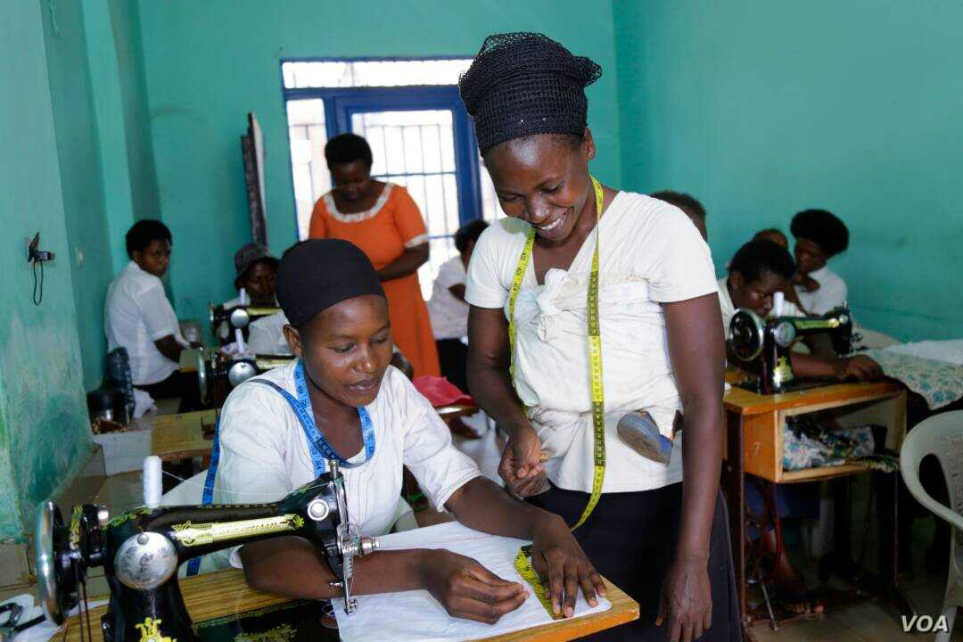 Young women enrolled at the Safi Center, near Kigali, Rwanda, learn income-generating skills such as sewing. (Photo by Christian Gakombe/Safi Center)