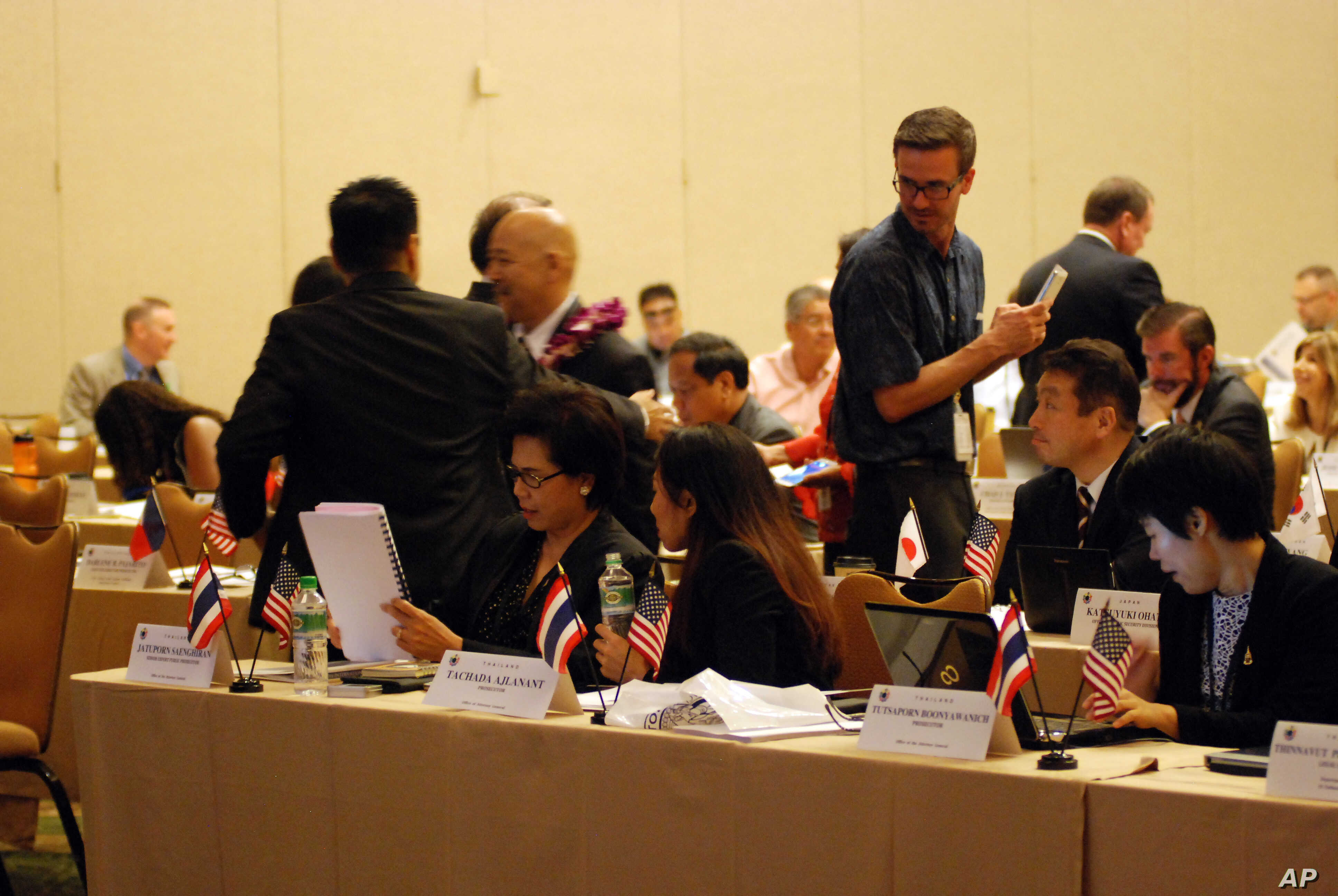 FILE - Prosecutors from Thailand, Japan and other countries talk at a summit on sex trafficking, Sept. 28, 2016, in Honolulu. They called the scourge of sex trafficking a form of modern-day slavery.