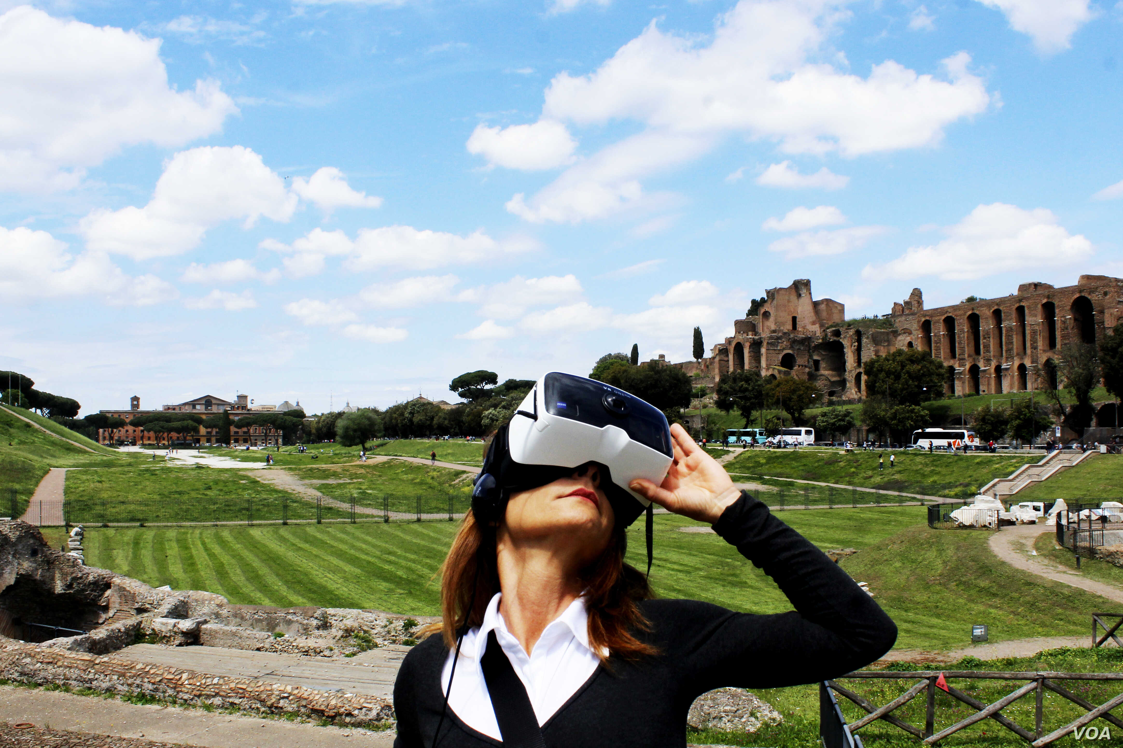 A visitor of Rome's Circus Maximus is seen with a virtual reality visor.