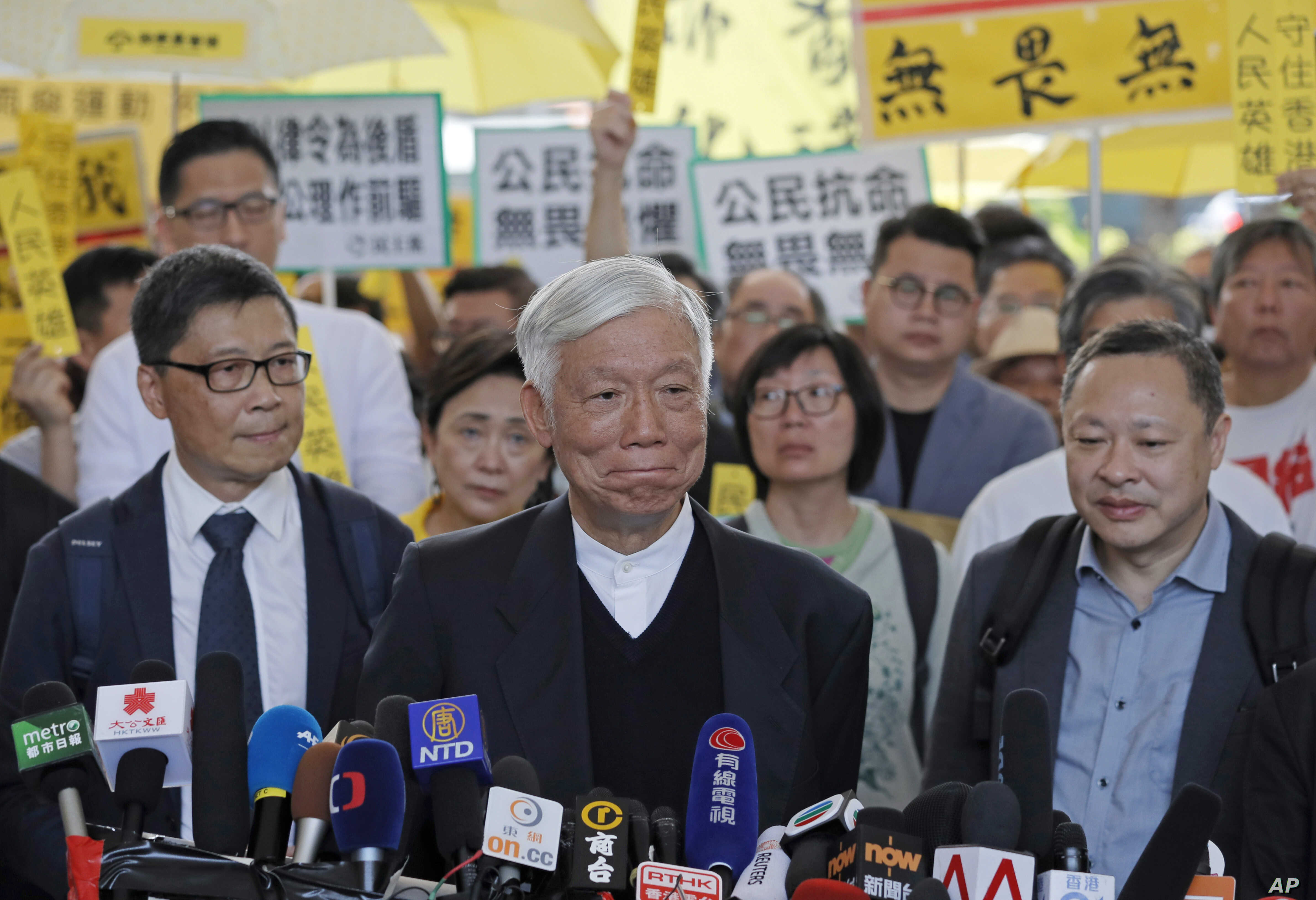 Occupy Central leaders, from right, Benny Tai, Chu Yiu-ming and Chan Kin-man speak before entering a court in Hong Kong, April 9, 2019.