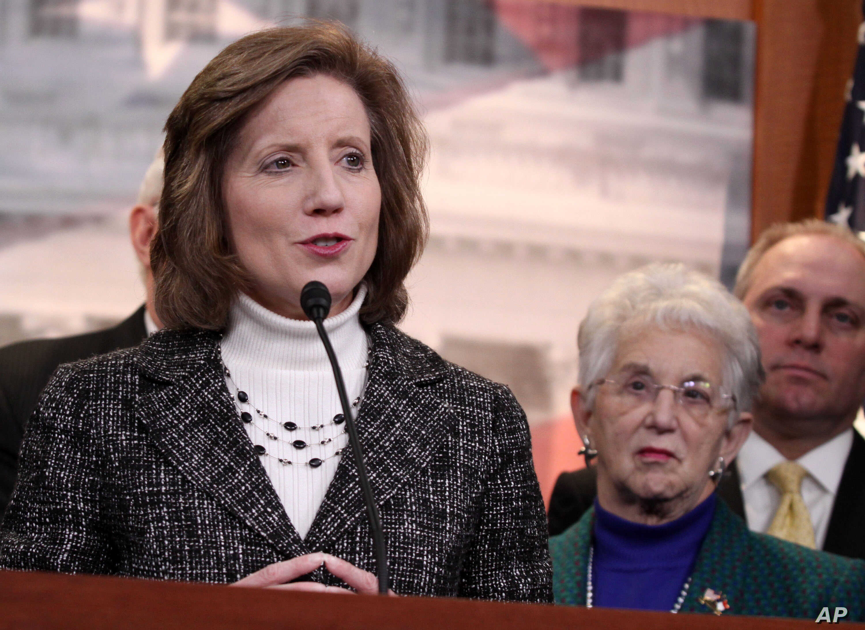 FILE - Rep. Vicky Hartzler, R-Mo., left, speaks to reporters on Capitol Hill in Washington, March 25, 2014.
