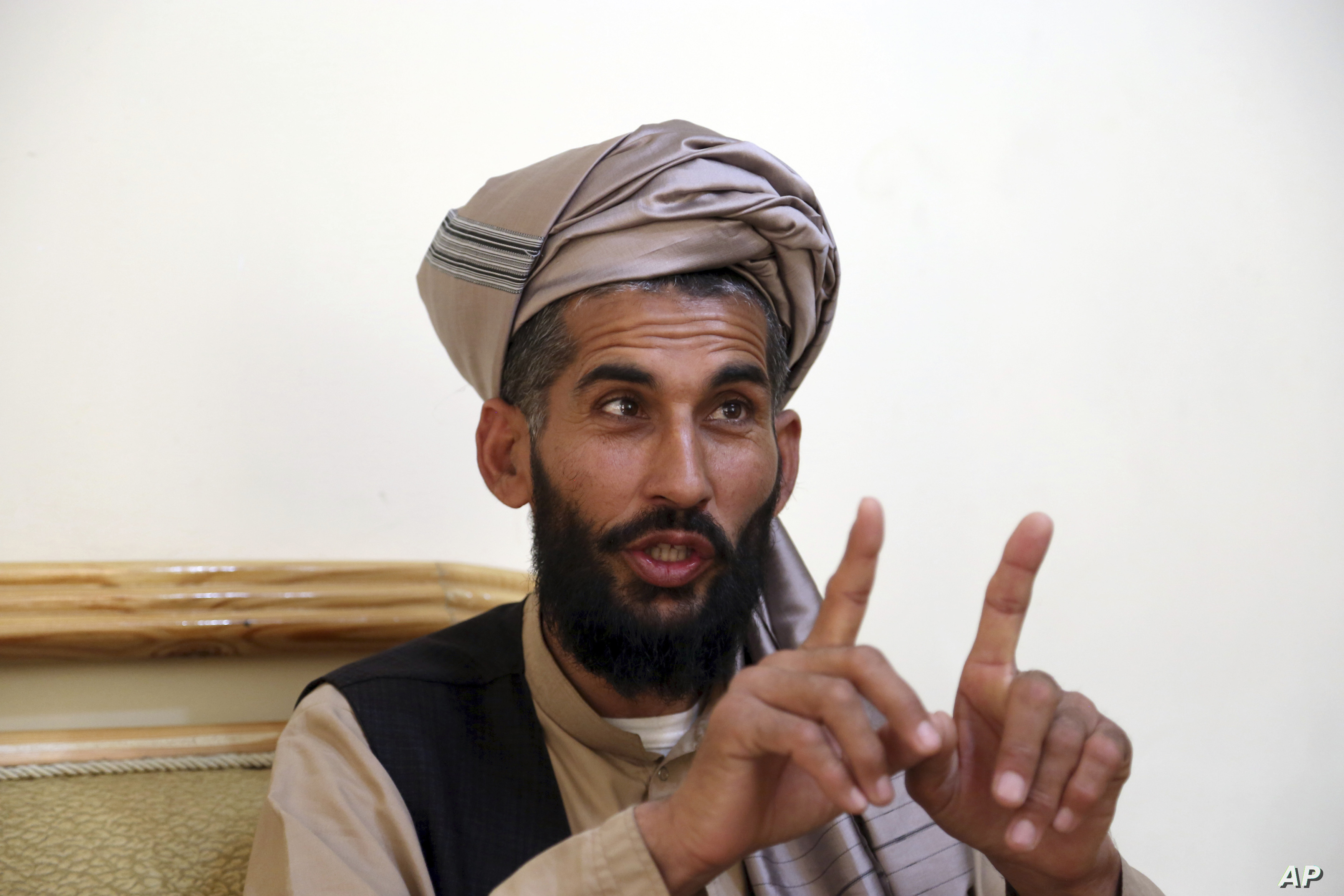 Masih Rahman speaks during an interview with the Associated Press in Kabul, Afghanistan, April 23, 2019. In September last year Masih Rahman's entire family of 11 people, his wife, four daughters, three sons and four nephews, were killed when a bomb ...