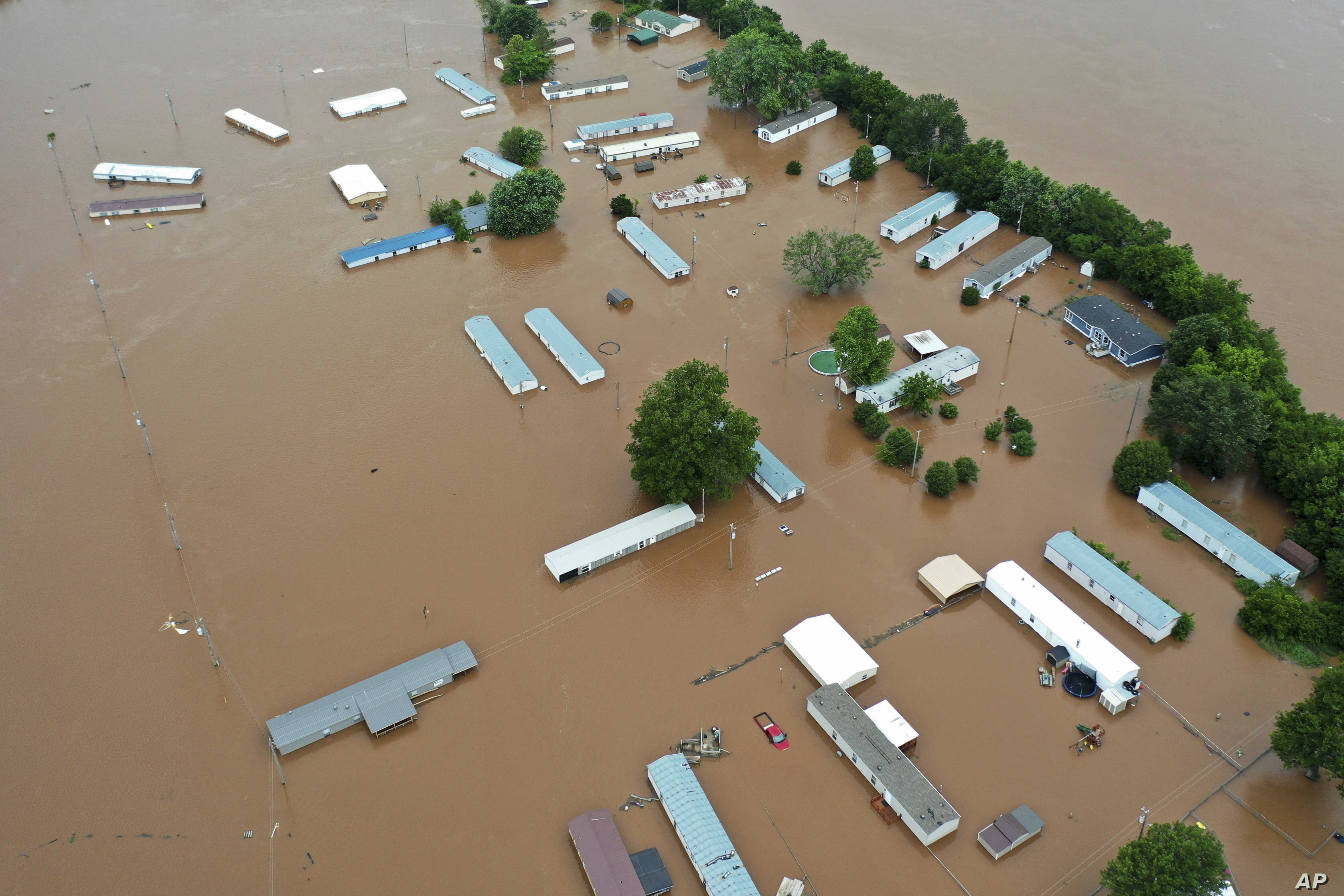 Homes are flooded along the Arkansas River in Sand Spring, Okla., May 28, 2019.