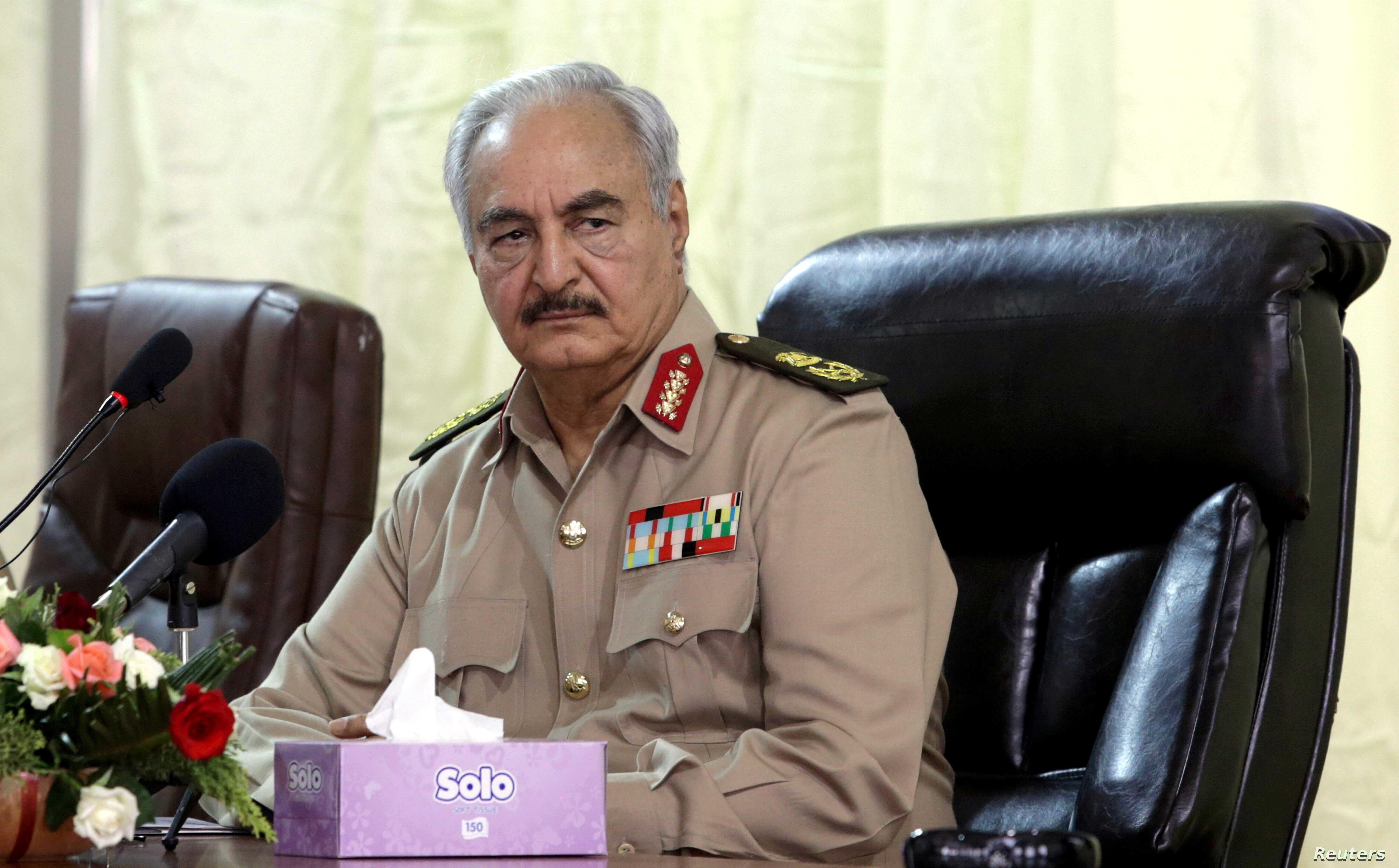 FILE - Libya's eastern-based commander Khalifa Haftar attends General Security conference, in Benghazi, Libya, Oct. 14, 2017.