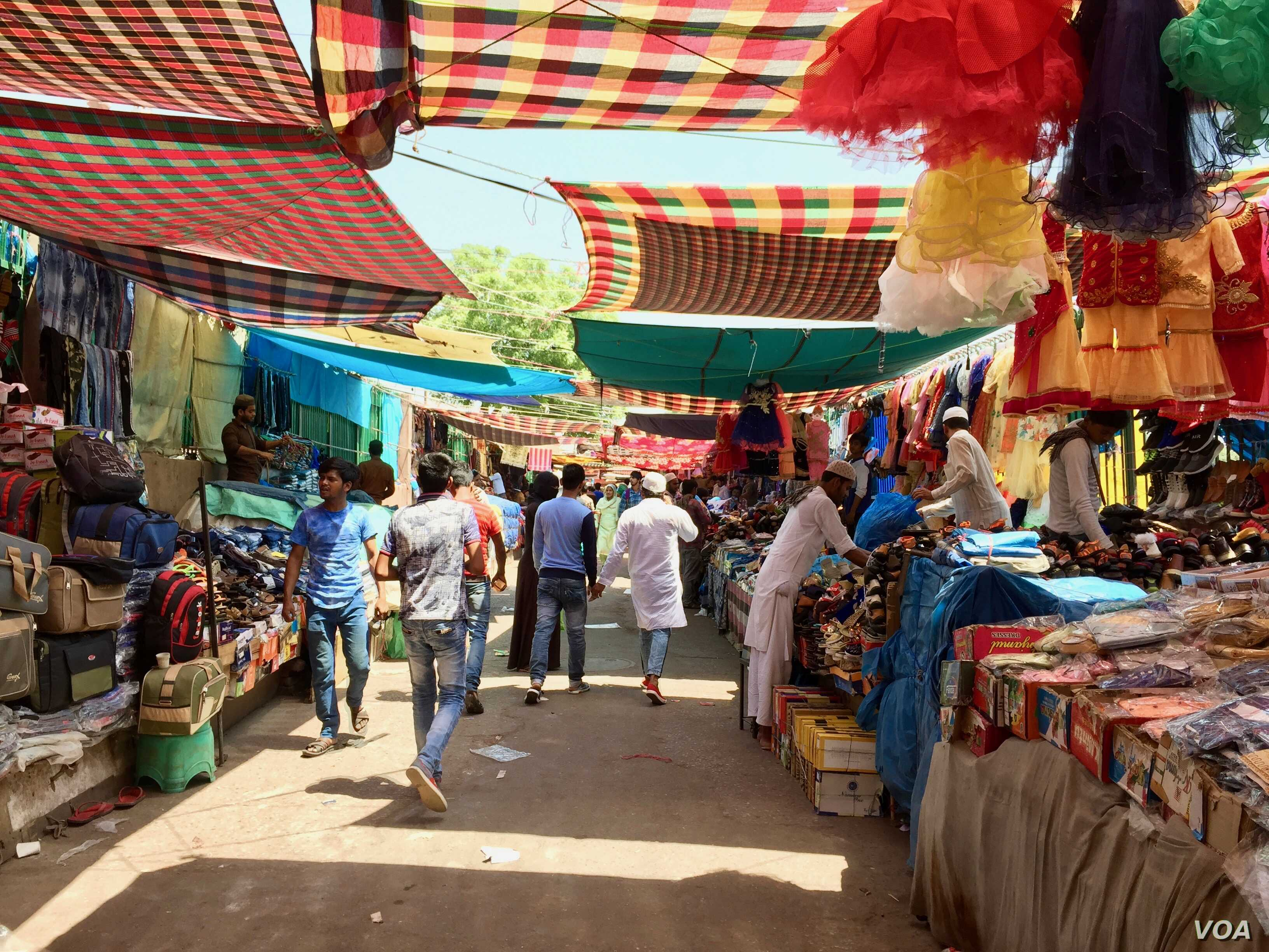 Despite the heat, shoppers throng a colorful market near an iconic Jama Masjid mosque in the Indian capital.
