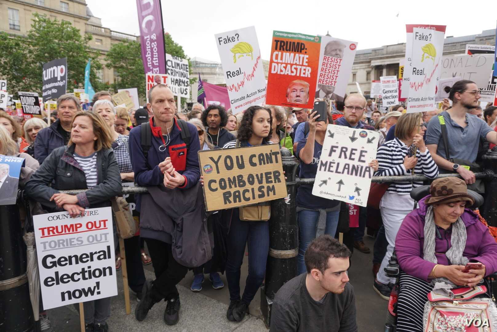 Thousands of anti-Trump protesters gathered in London's Trafalgar Square ahead of a march down Whitehall to within shouting distance of the U.S. President as he held talks with Theresa May, Britain's outgoing prime minister. (J. Dettmer for VOA)