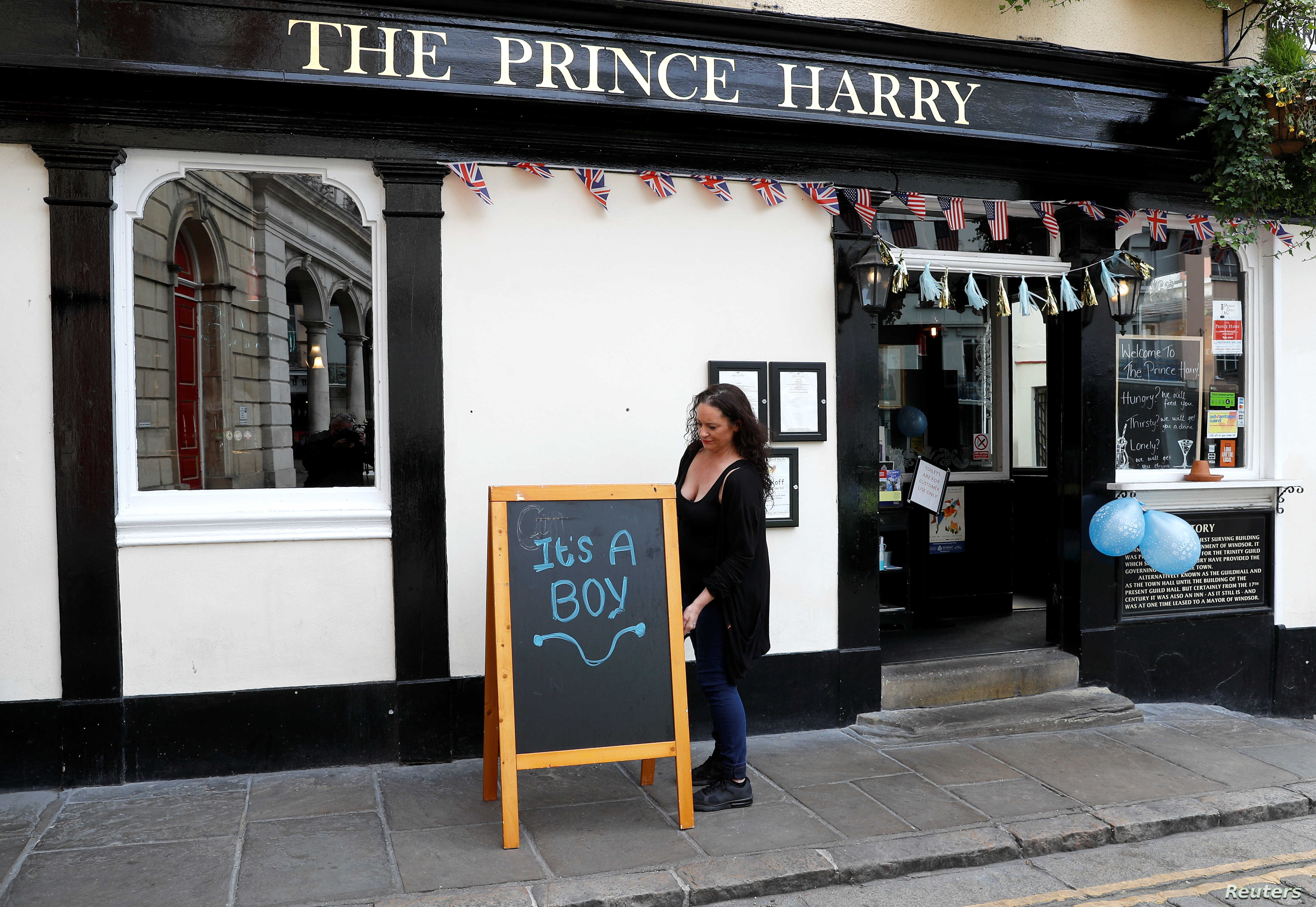 "A sign reading ""It's a boy"" is pictured a day after Meghan, Duchess of Sussex, gave birth to a baby boy, outside the Prince Harry pub in Windsor, Britain May 7, 2019."