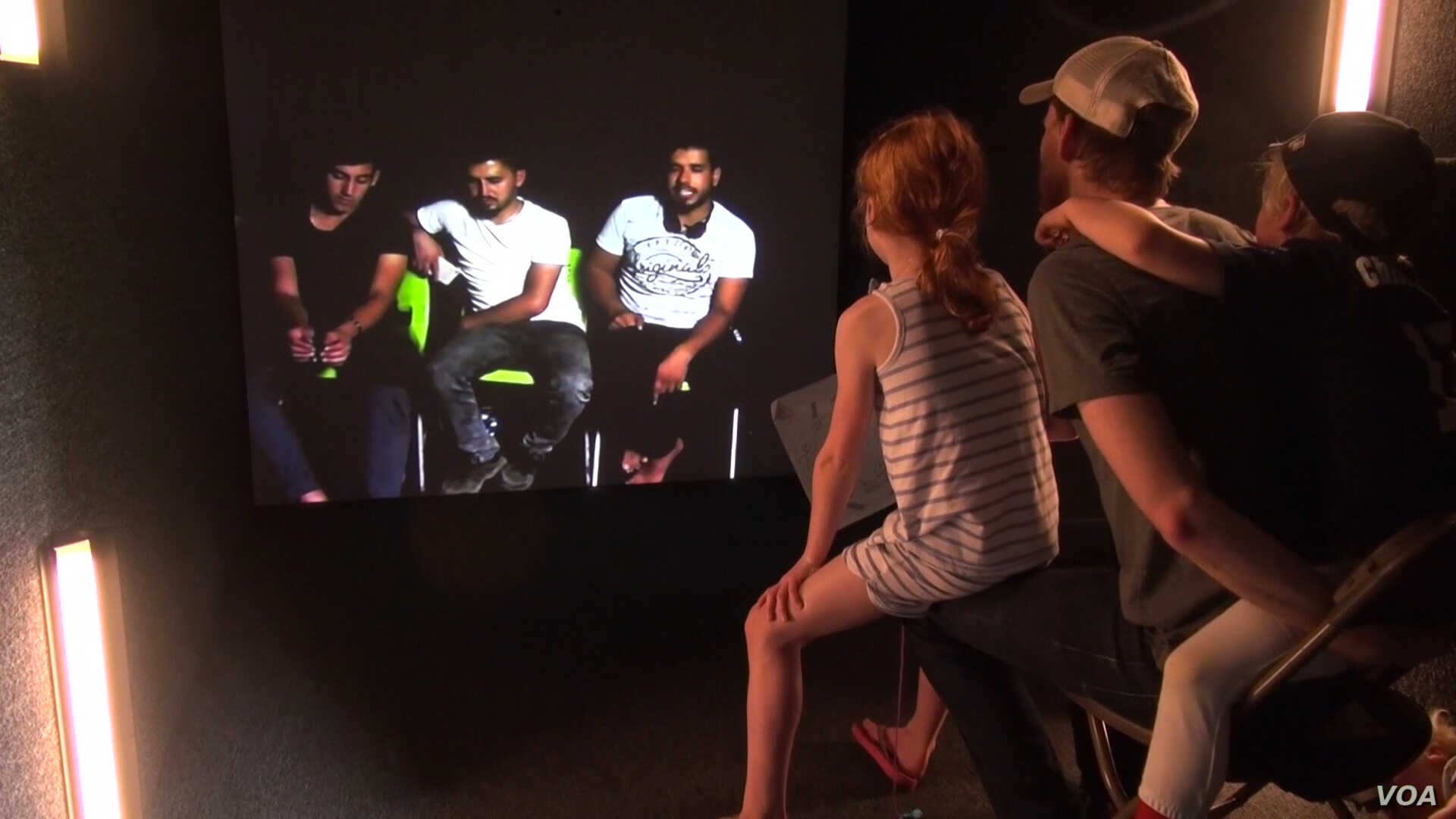 Iraqi refugees living at a refugee camp and festival attendees in Washington interact directly through a digital portal called Shared Studio, which was set up at the One Journey festival in last June.