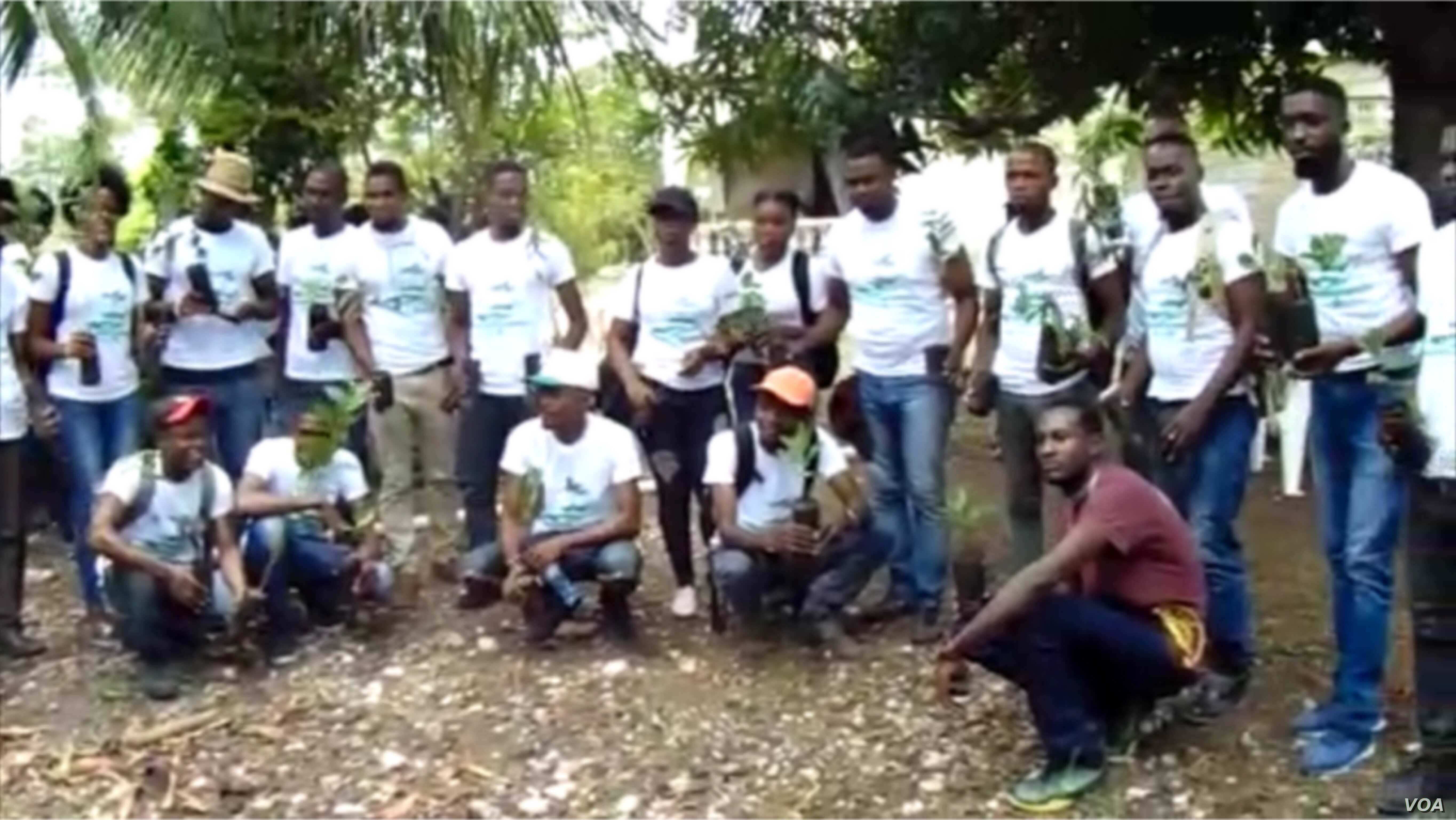 Members of Rotaract Club hold prepare to plant trees in Beret, Haiti for World Environment Day.