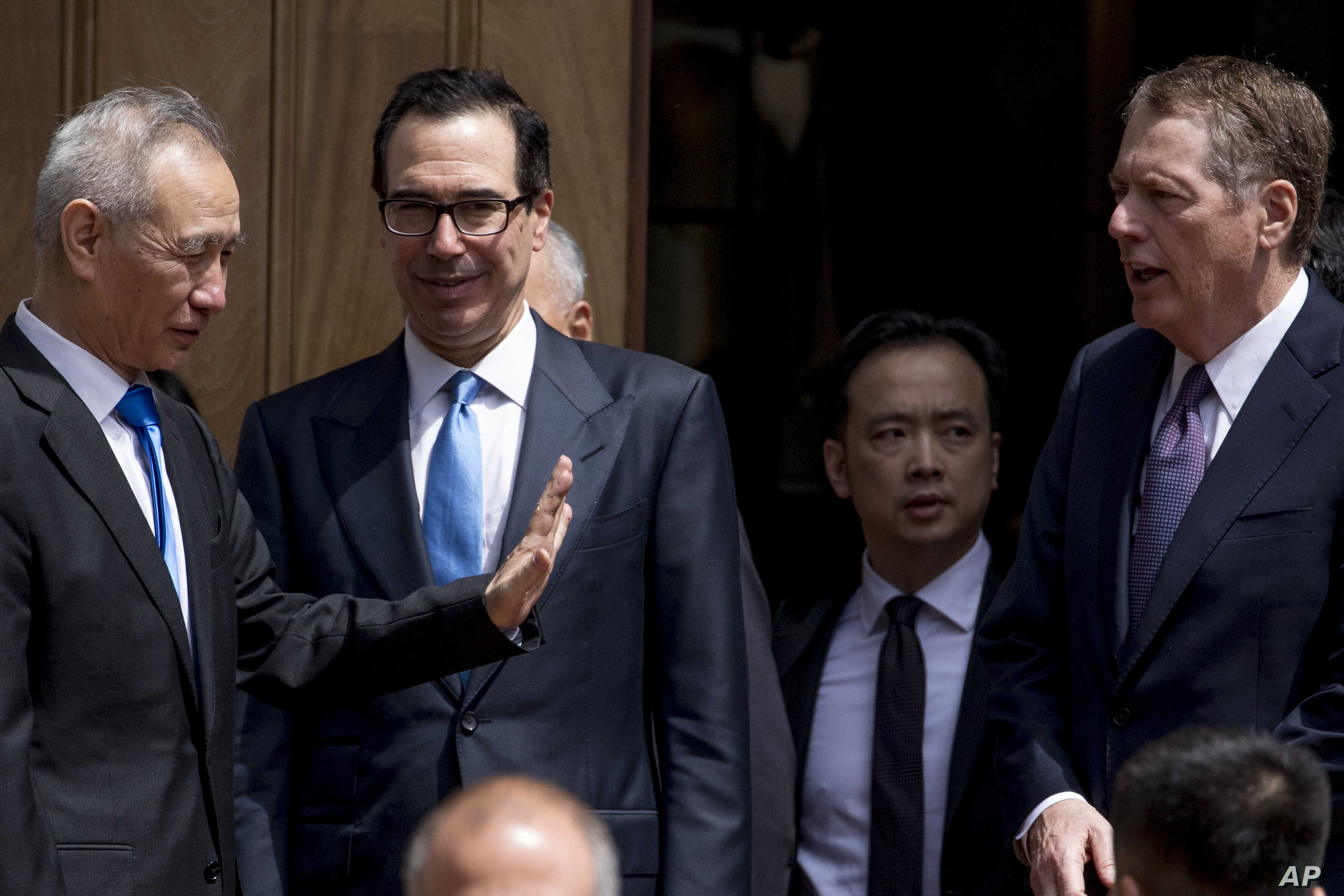 U.S. Treasury Secretary Steve Mnuchin, second from left, and U.S. Trade Representative Robert Lighthizer, right, speak with Chinese Vice Premier Liu He, left, as he departs the Office of the United States Trade Representative in Washington, May 10, 2...