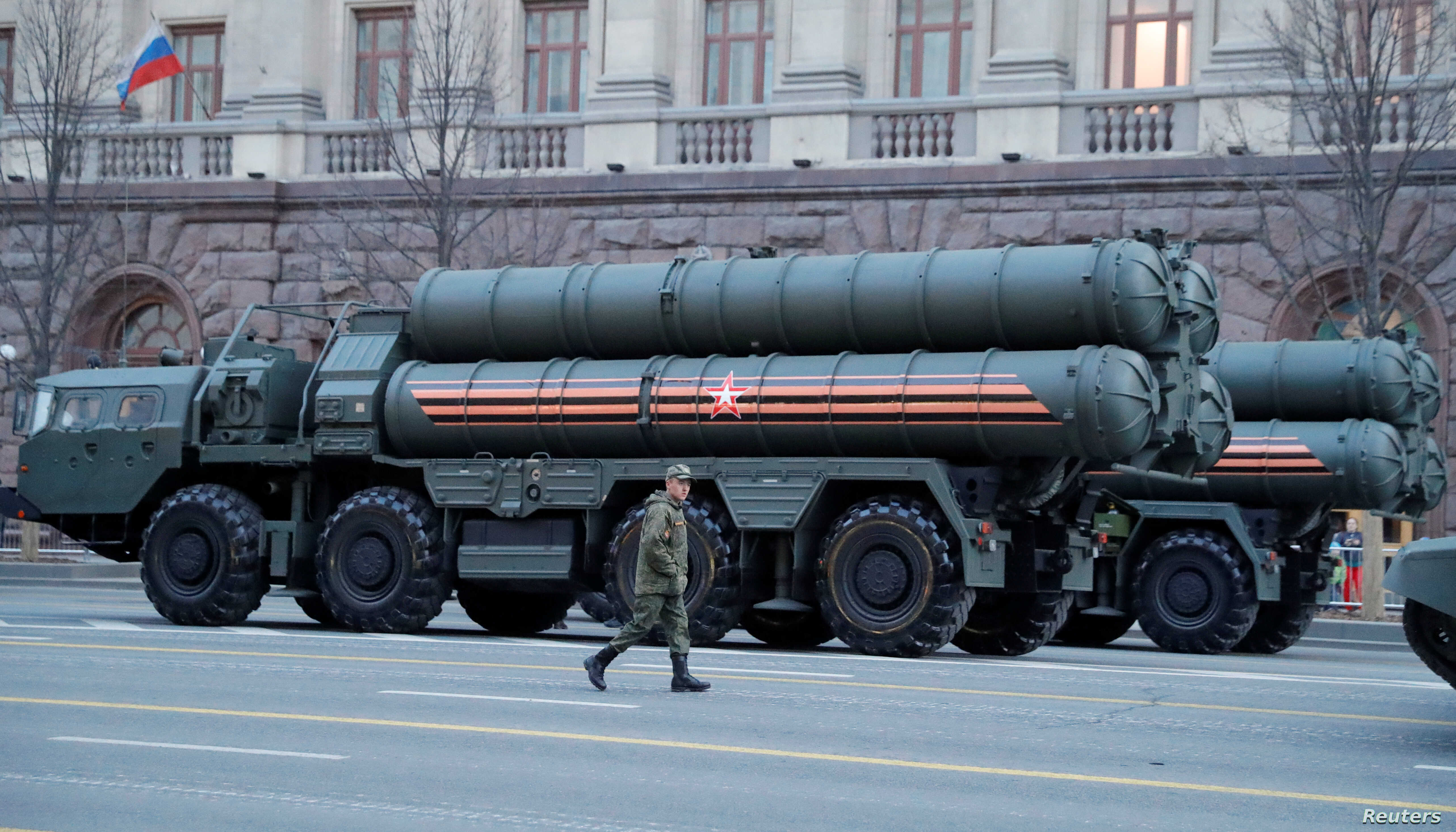 A Russian serviceman walks past S-400 missile defense systems in Tverskaya Street before a rehearsal for the Victory Day parade, which marks the anniversary of the victory over Nazi Germany in World War Two, in central Moscow, Russia, April 29, 2019. REUTERS/Tatyana Makeyeva - RC154CE7FE30