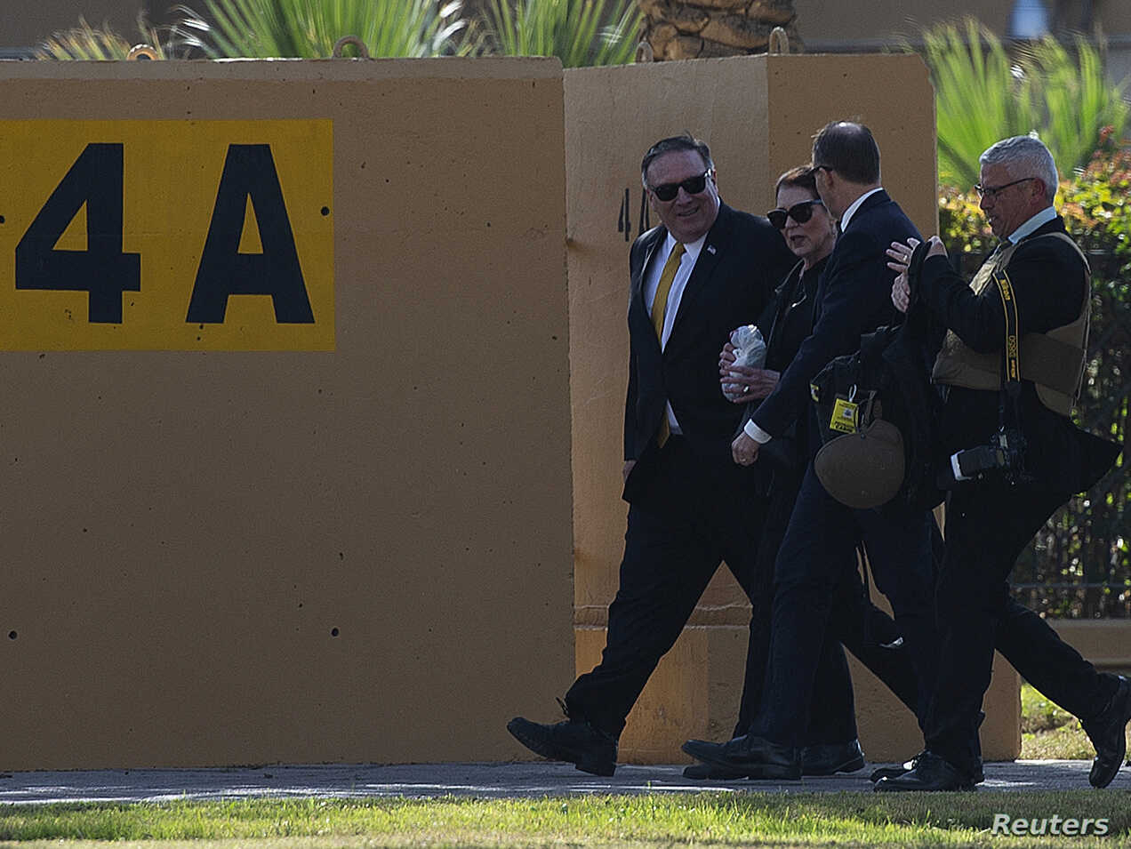 FILE - U.S. Secretary of State Mike Pompeo and his wife, Susan, walk at the U.S. Embassy compound in Baghdad, Jan. 9, 2019. The U.S. has ordered all non-essential personnel to leave the Iraq embassy.