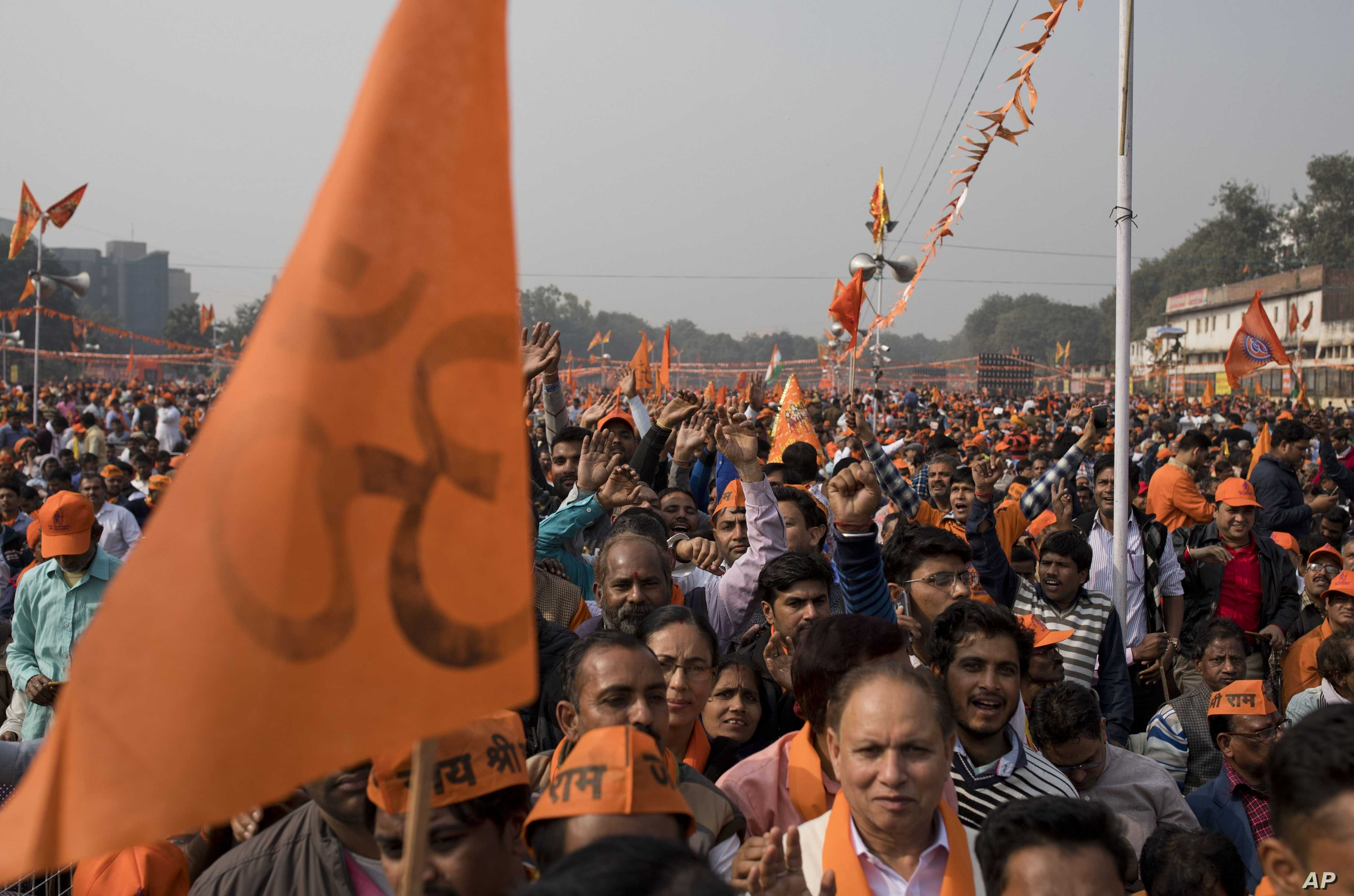 Supporters of Vishwa Hindu Parishad gather during a rally in New Delhi, Dec. 9, 2018. The right-wing group gathered thousands of supporters in the Indian capital to demand the construction of a Hindu temple on a site where a mosque was attacked and d...
