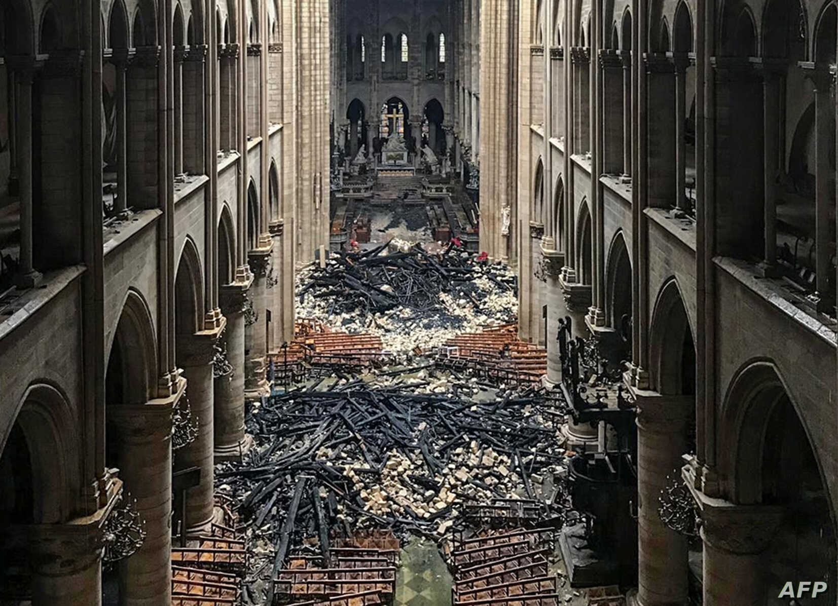 An interior view of the Notre-Dame Cathedral in Paris in the aftermath of a fire that devastated the cathedral, April 16, 2019.