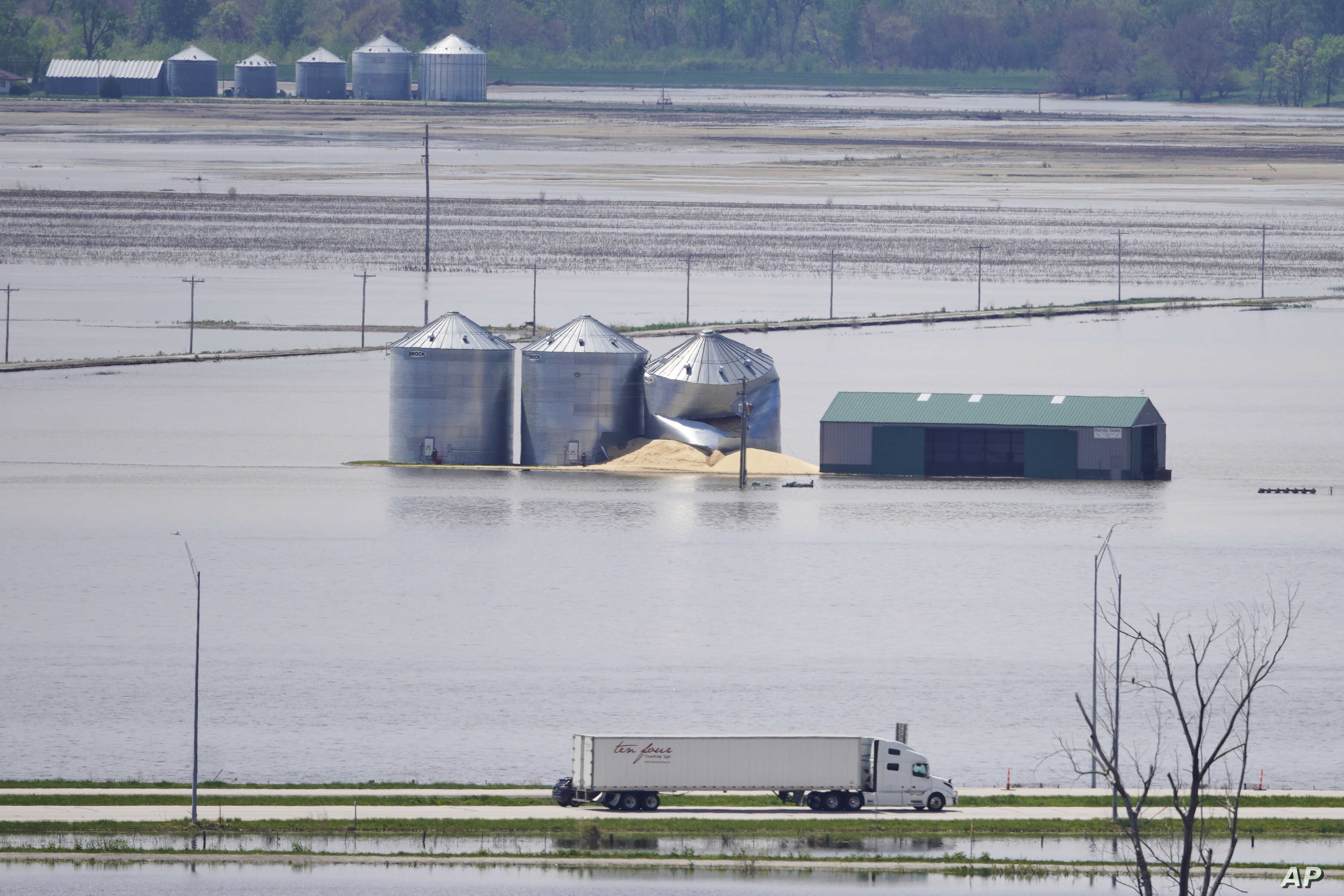 Grain bins stand in floodwaters from the Missouri River, in Hamburg, Iowa, May 10, 2019.