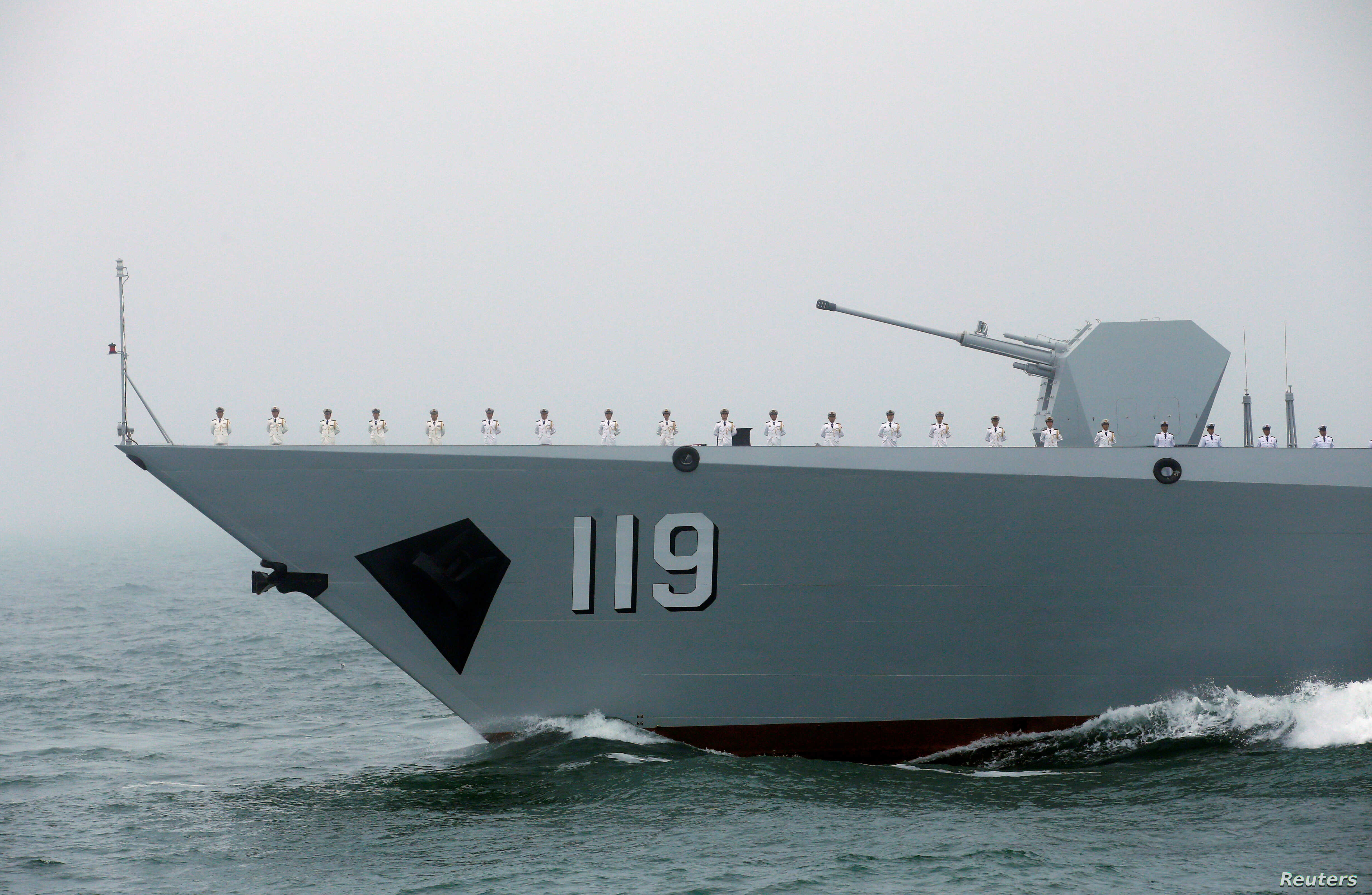 FILE - The Chinese navy's guided missile destroyer Guiyang takes part in a naval parade off the eastern port city of Qingdao, April 23, 2019.
