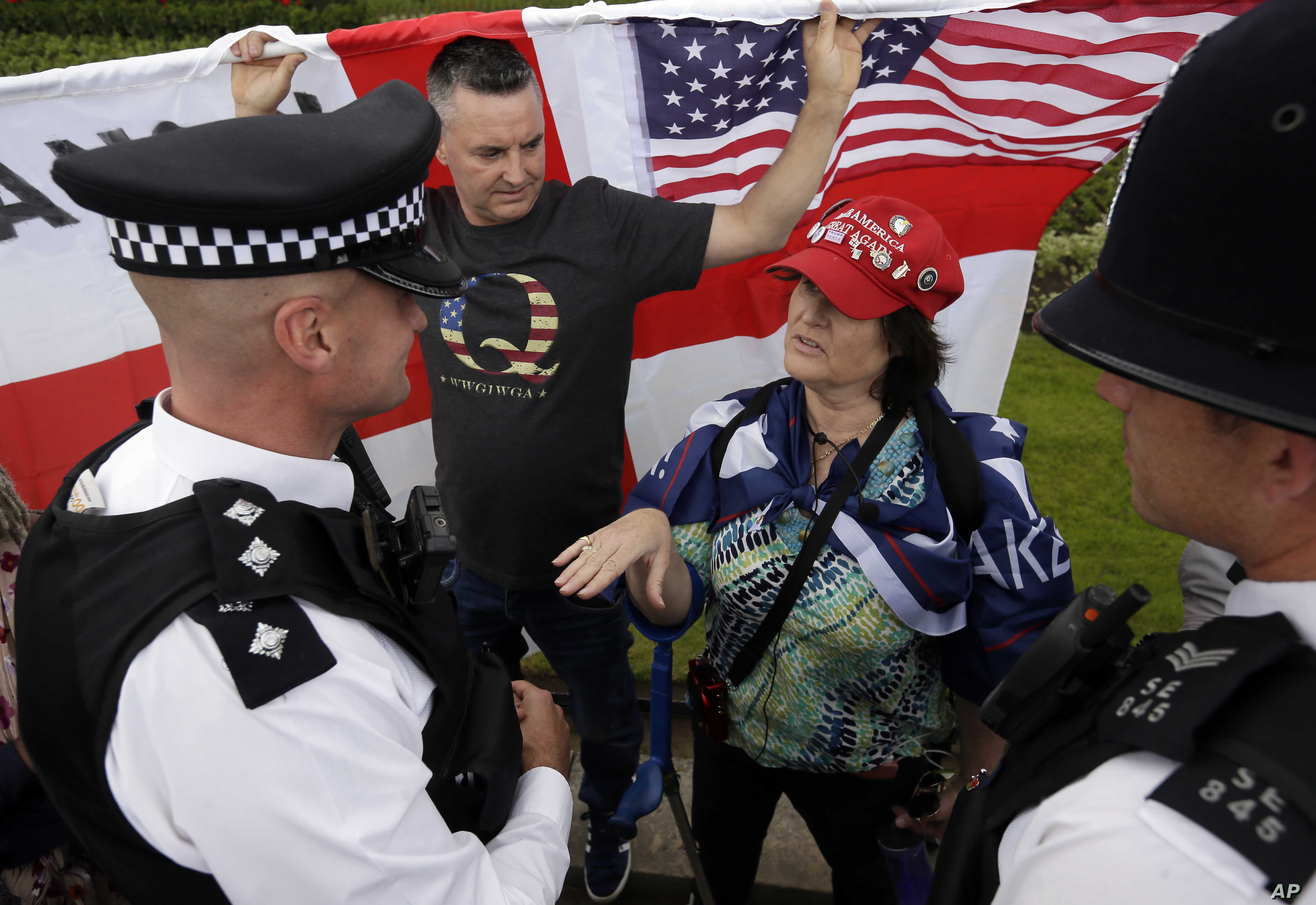 A fan of Donald Trump is asked to move out of the street by police outside Buckingham Palace in London, June 3, 2019.