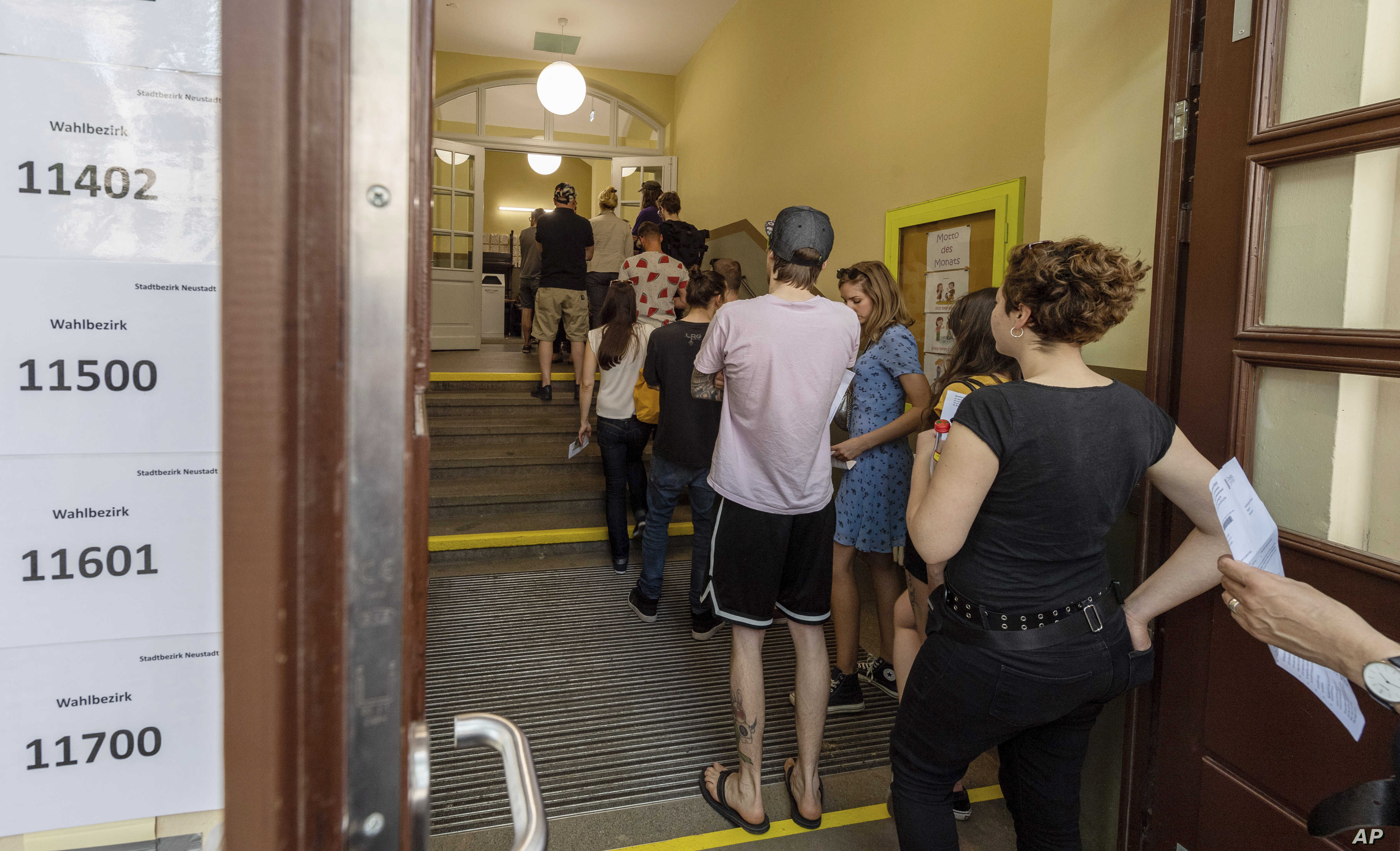 Voters line up at a polling station for European Parliament elections in Dresden, Germany, May 26, 2019.