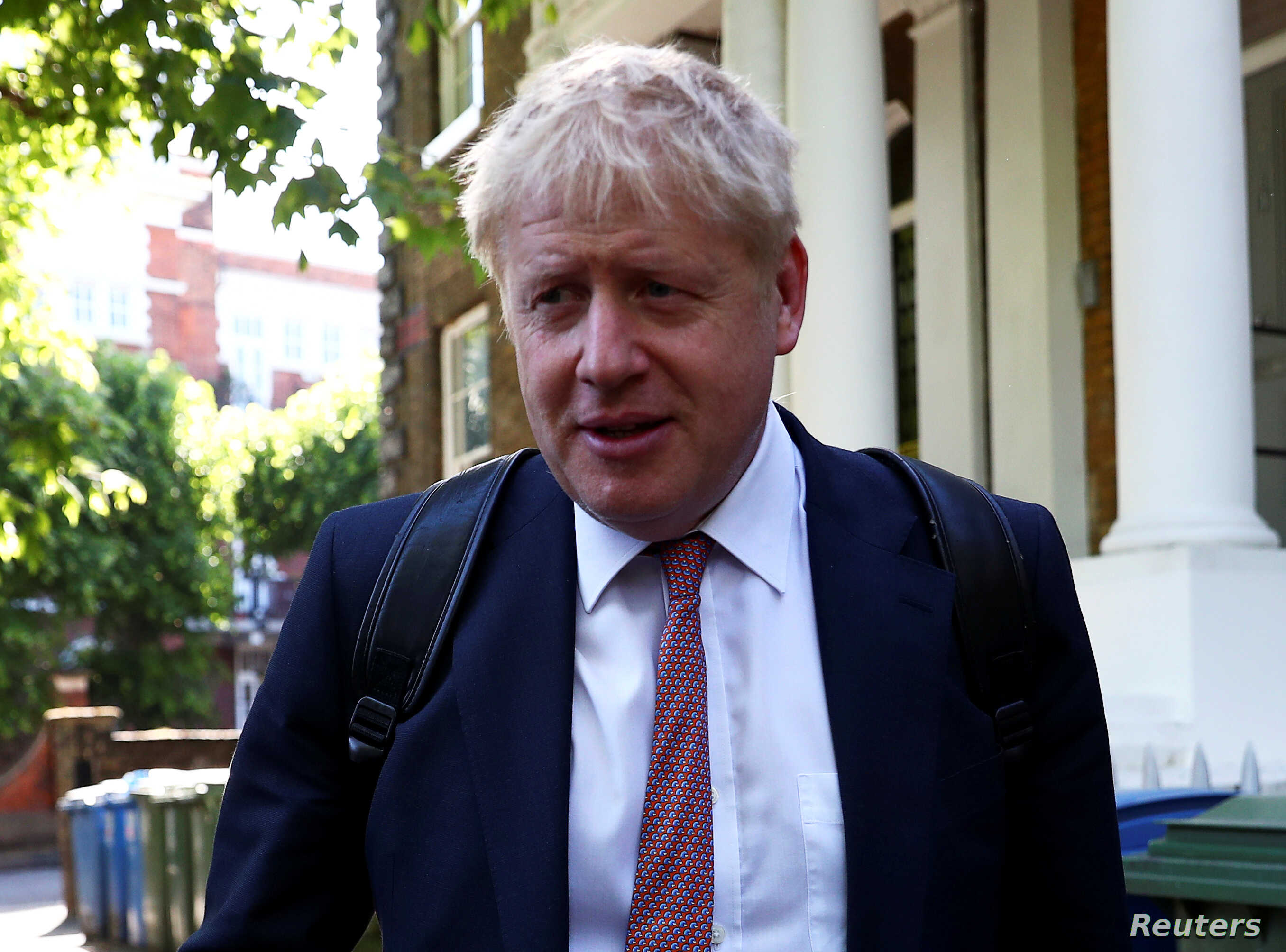 FILE - Former British Foreign Secretary Boris Johnson, who is running to succeed Theresa May as prime minister, leaves his home in London, May 30, 2019.