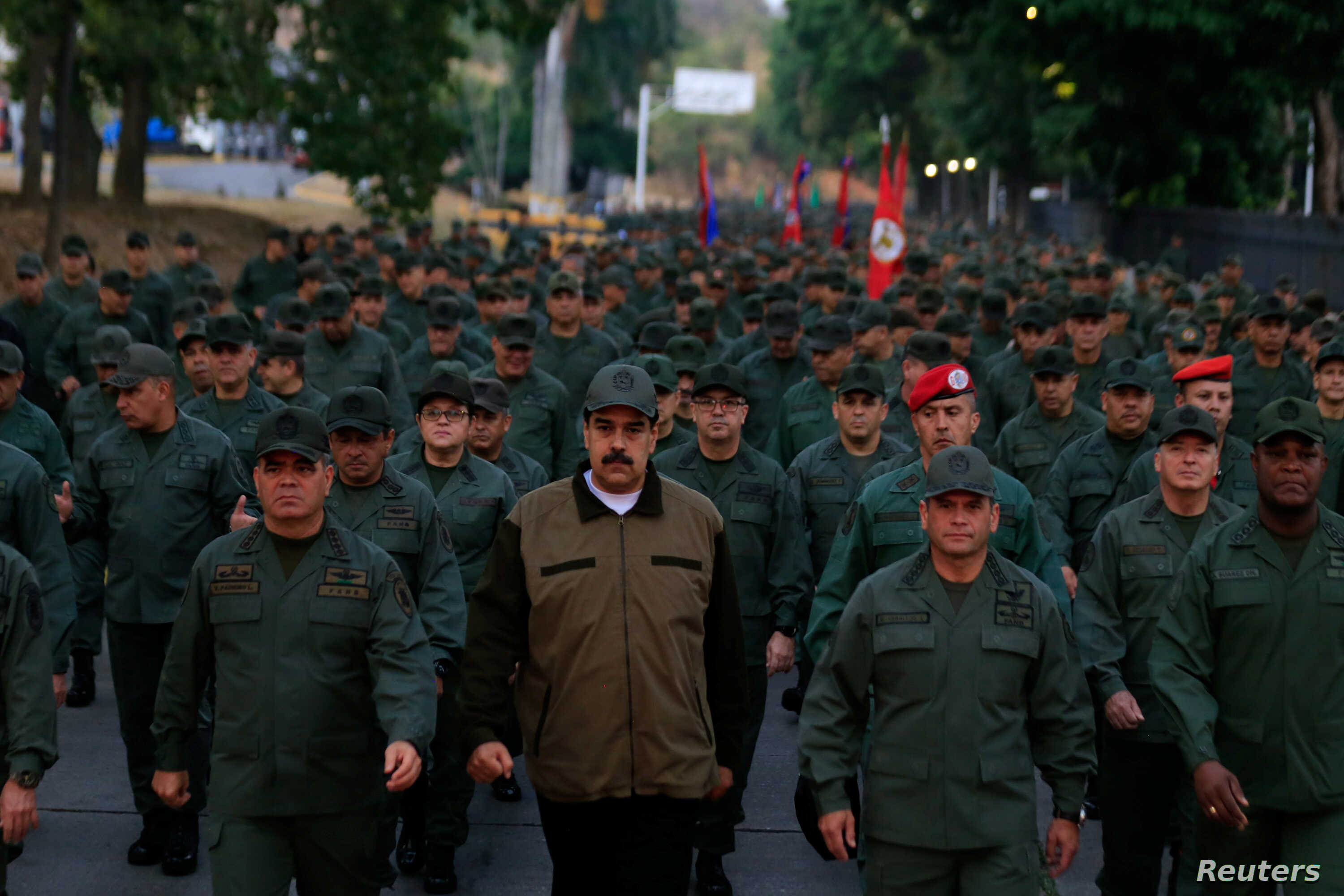 Venezuela's President Nicolas Maduro walks next to Venezuela's Defense Minister Vladimir Padrino Lopez and Remigio Ceballos, Strategic Operational Commander of the Bolivarian National Armed Forces, during a ceremony at a military base in Caracas, Ven...
