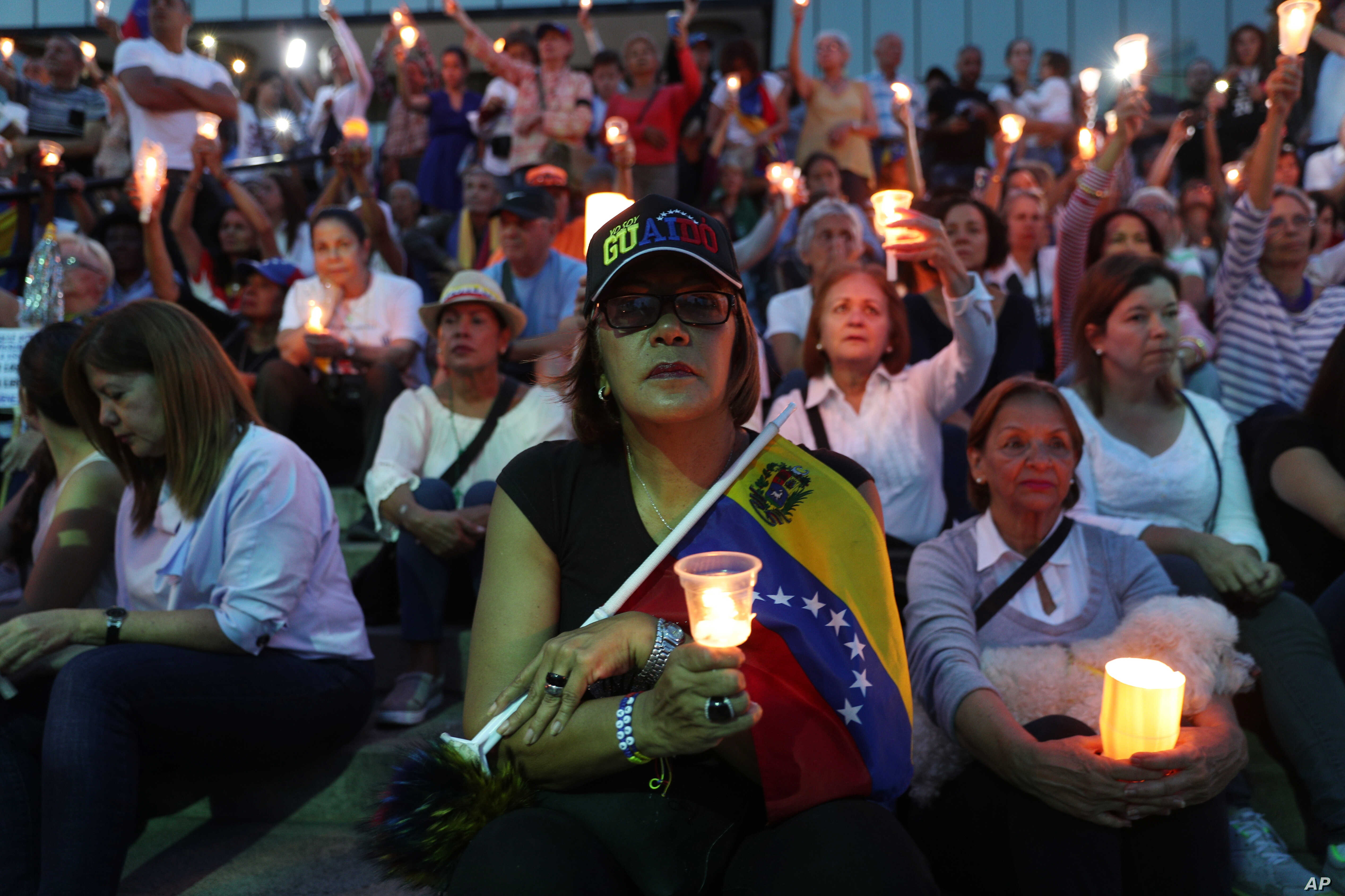 Opponents to Venezuela's President Nicolas Maduro hold a vigil for those killed in street fighting over the past week in Caracas, Venezuela, May 5, 2019.