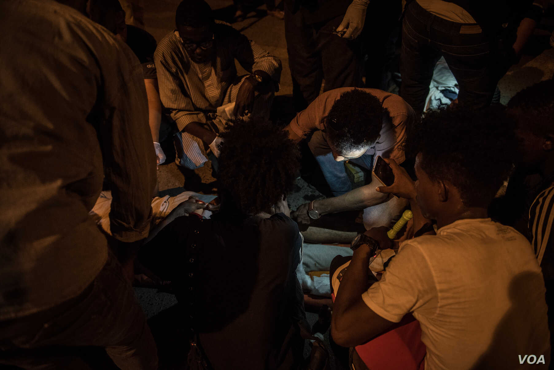 Medical staff treat a wounded protester in Khartoum on the night of May 13 2019. (J. Patinkin for VOA)