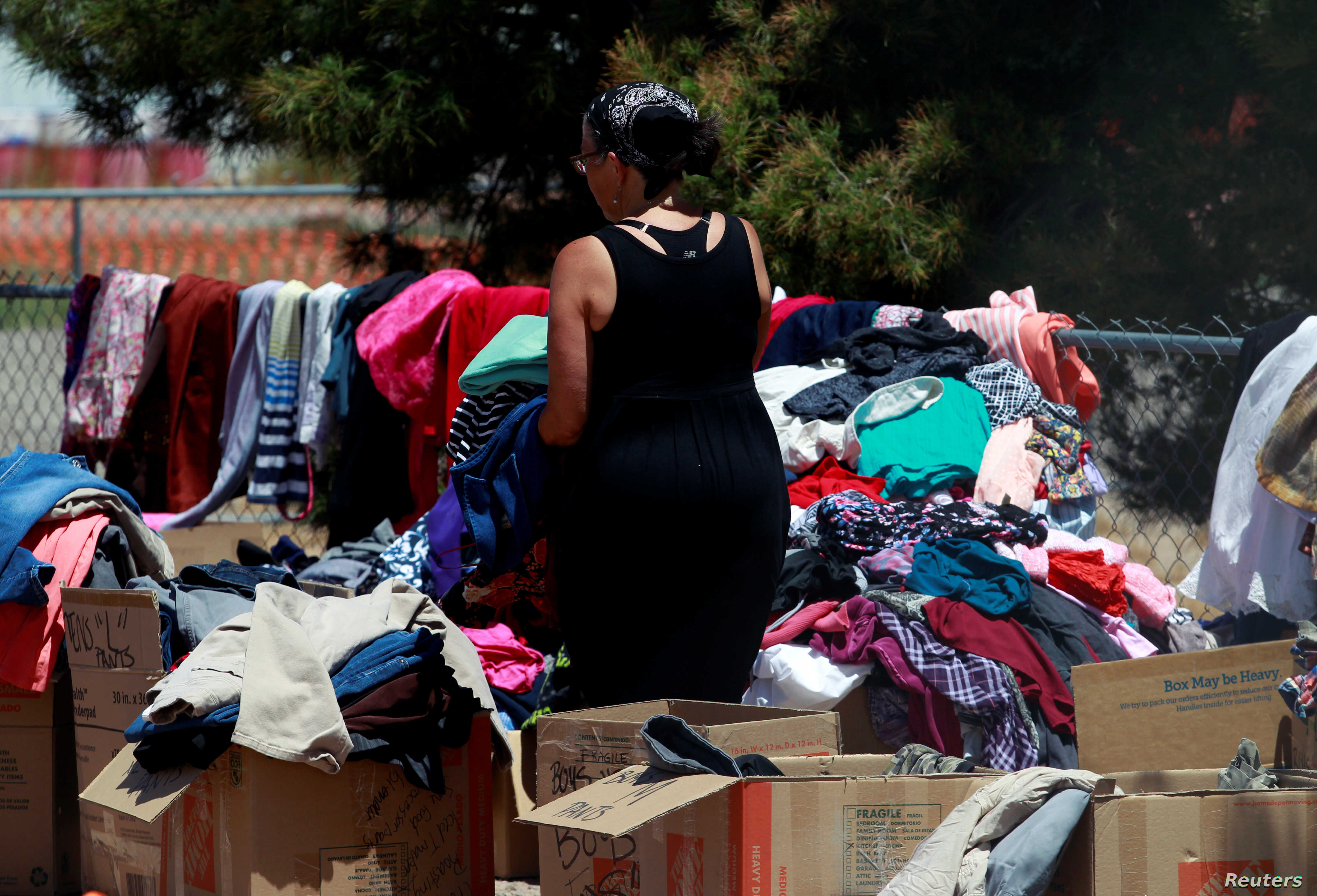 A volunteer sorts clothes donated for Central American migrants who are being accommodated at a temporary shelter after illegally crossing the border between Mexico and the U.S., in Deming, New Mexico, May 16, 2019.