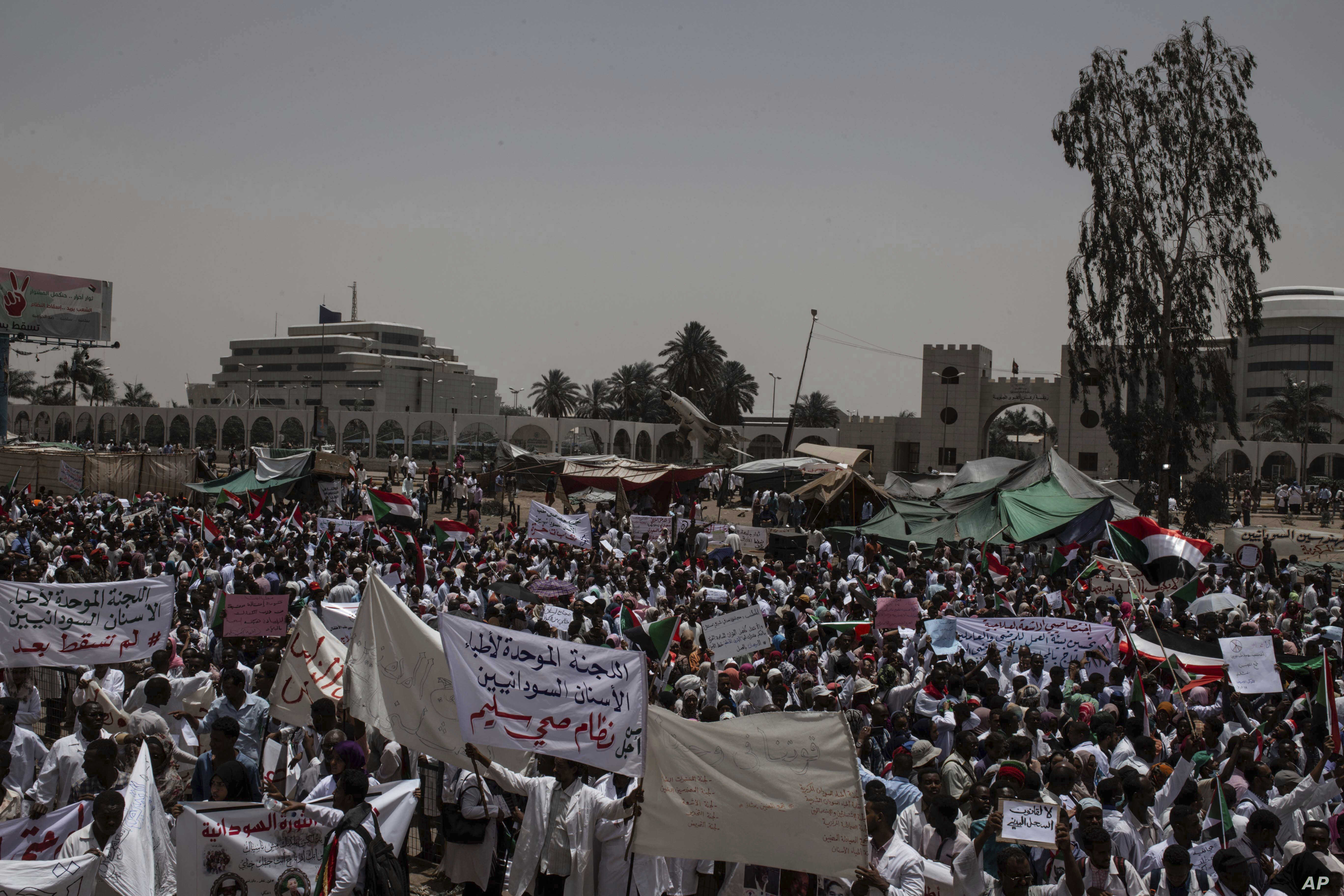 A group of protesters from the Sudanese medical profession syndicate march at the sit-in inside the Armed Forces Square, in Khartoum, Sudan, Wednesday, April 17, 2019.