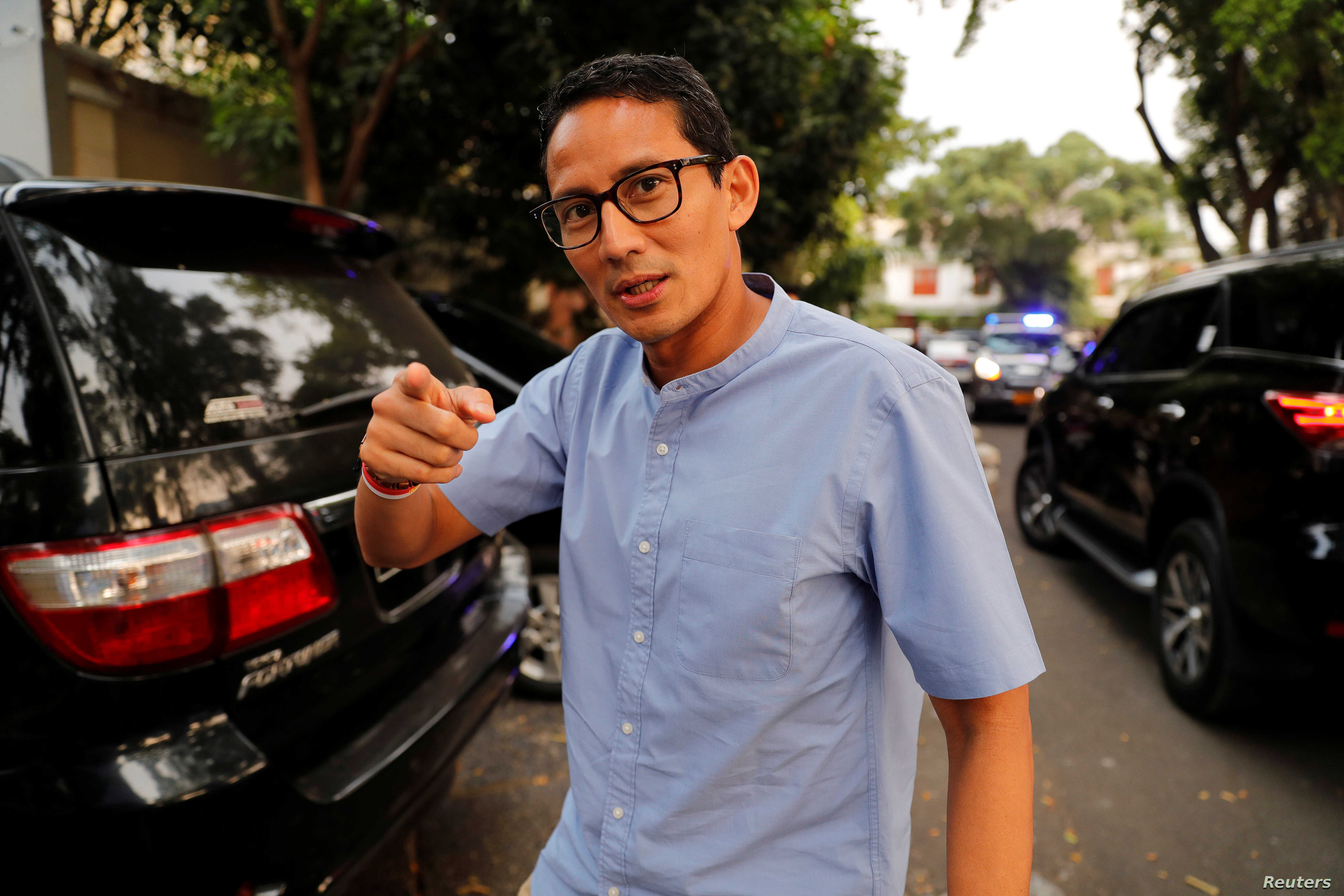 FILE - Indonesian vice president candidate Sandiaga Uno gestures as he walks in front of his house in Jakarta, Indonesia.