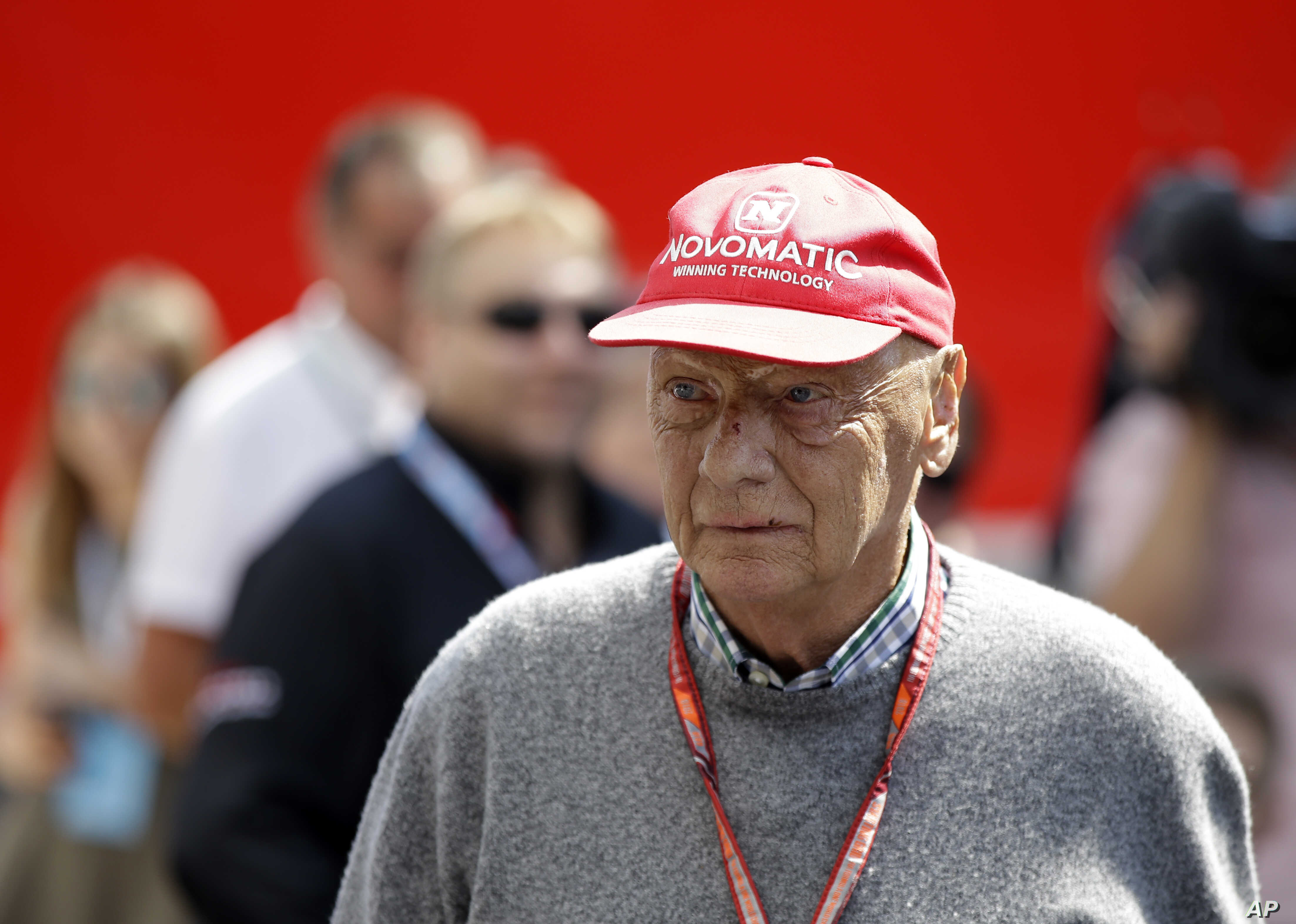 In this July 7, 2018 file photo former Formula One World Champion Niki Lauda of Austria walks in the paddock before the third free practice at the Silverstone racetrack, Silverstone, England.