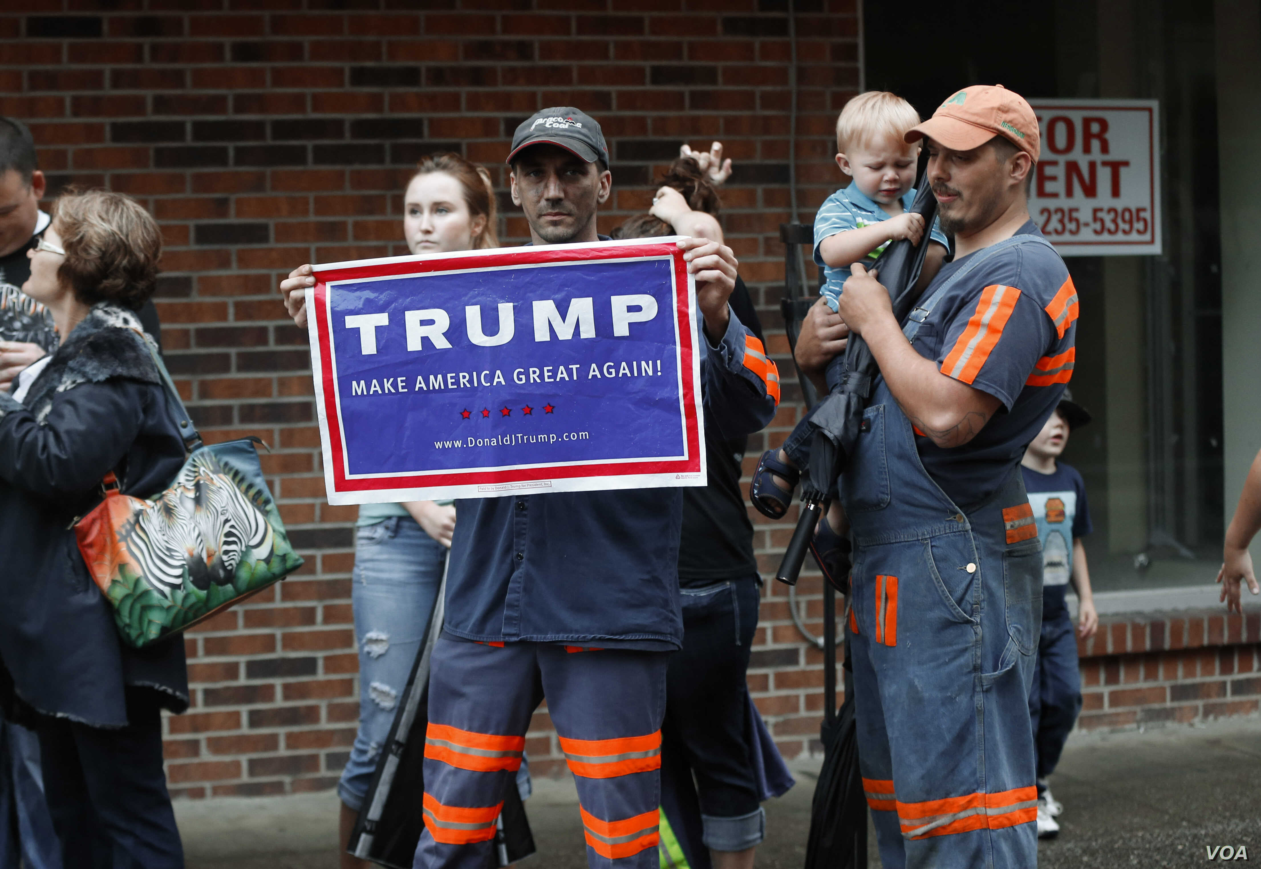 FILE - Coal miner Chris Steele holds a sign supporting Donald Trump outside a Democratic presidential candidate Hillary Clinton event in Williamson, W.V., May 2, 2016.