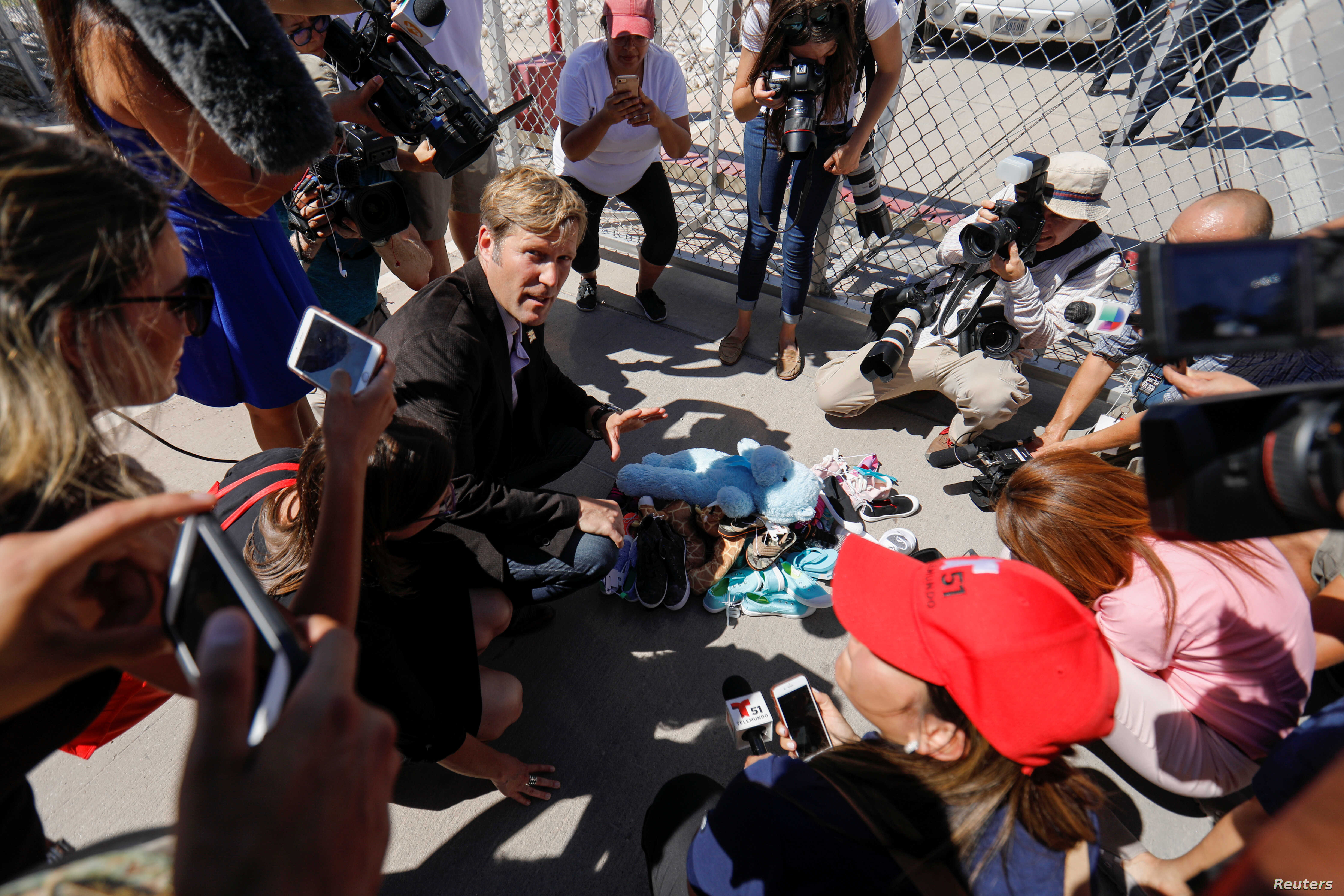"Albuquerque mayor Tim Keller leaves a stuff animal outside of the children's tent encampment built to deal with the Trump administrations ""zero tolerance"" policy in Tornillo, Texas, U.S. June 21, 2018."