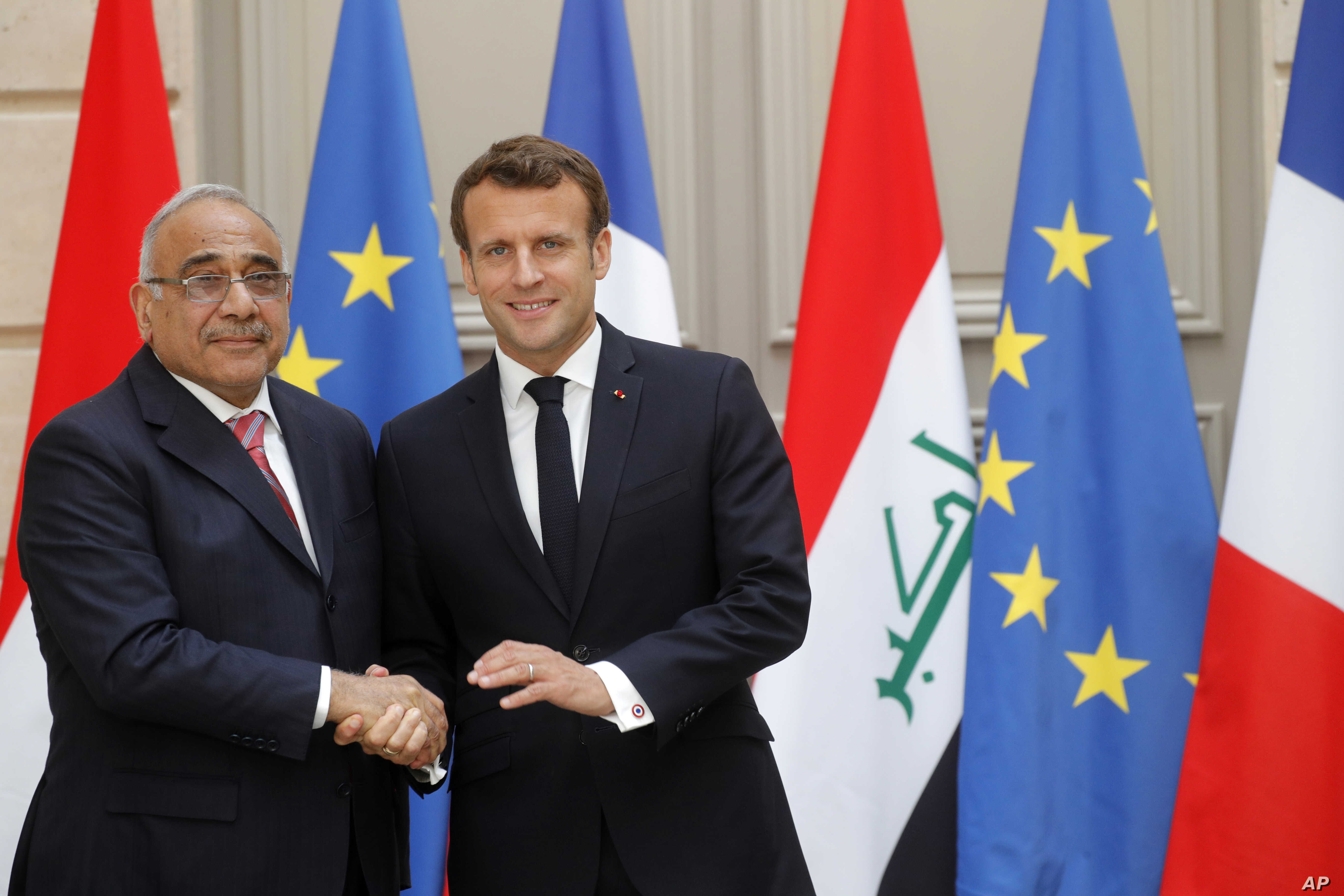 FILE - French President Emmanuel Macron skakes hands with Iraqi Prime Minister Adel Abdul-Mahdi after a joint statement at the Elysee Palace in Paris, France, May 3, 2019.
