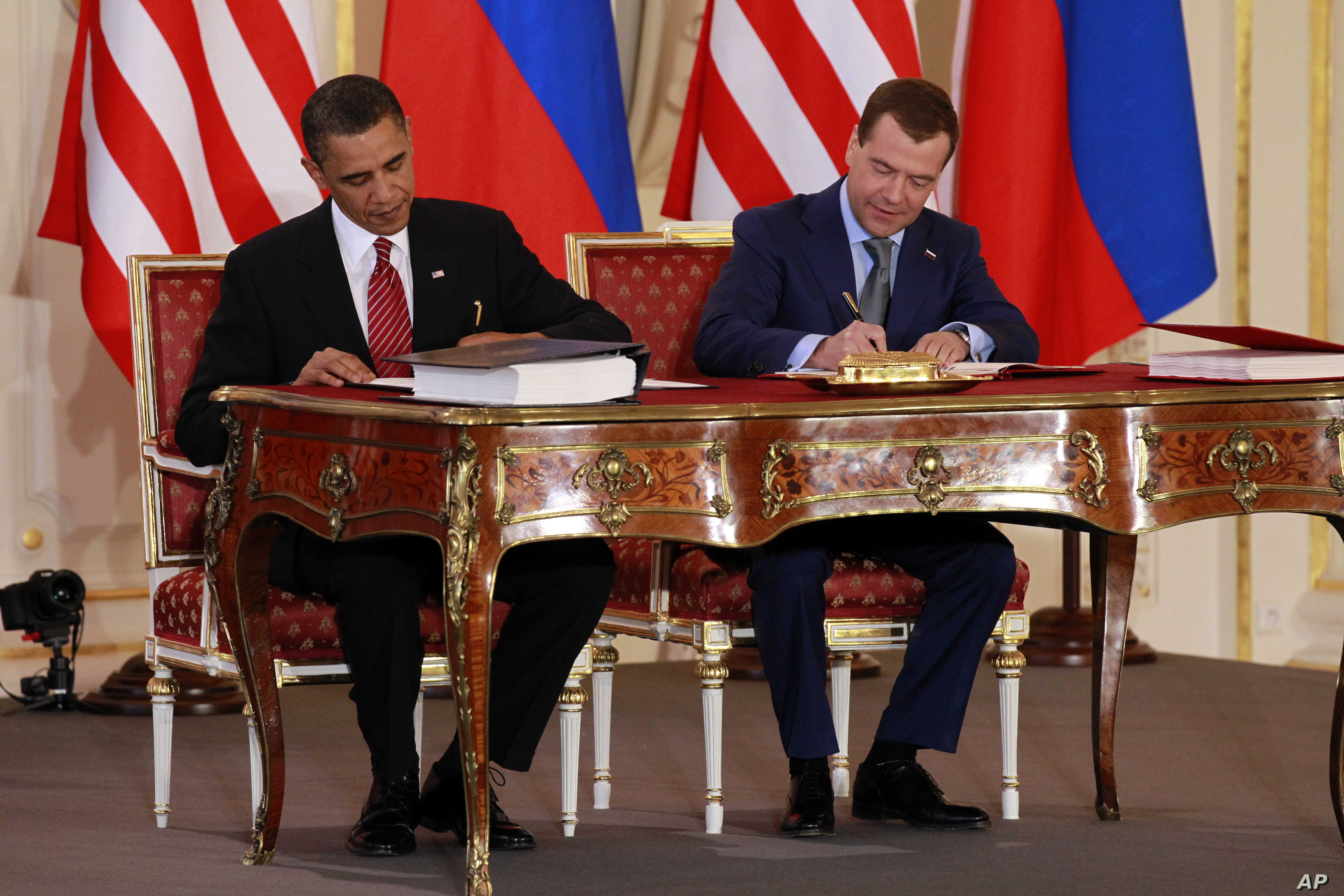 FILE - President Barack Obama, left, and Russian president Dmitry Medvedev sign the New START treaty at the Prague Castle in Prague in this, April 8, 2010 file photo.