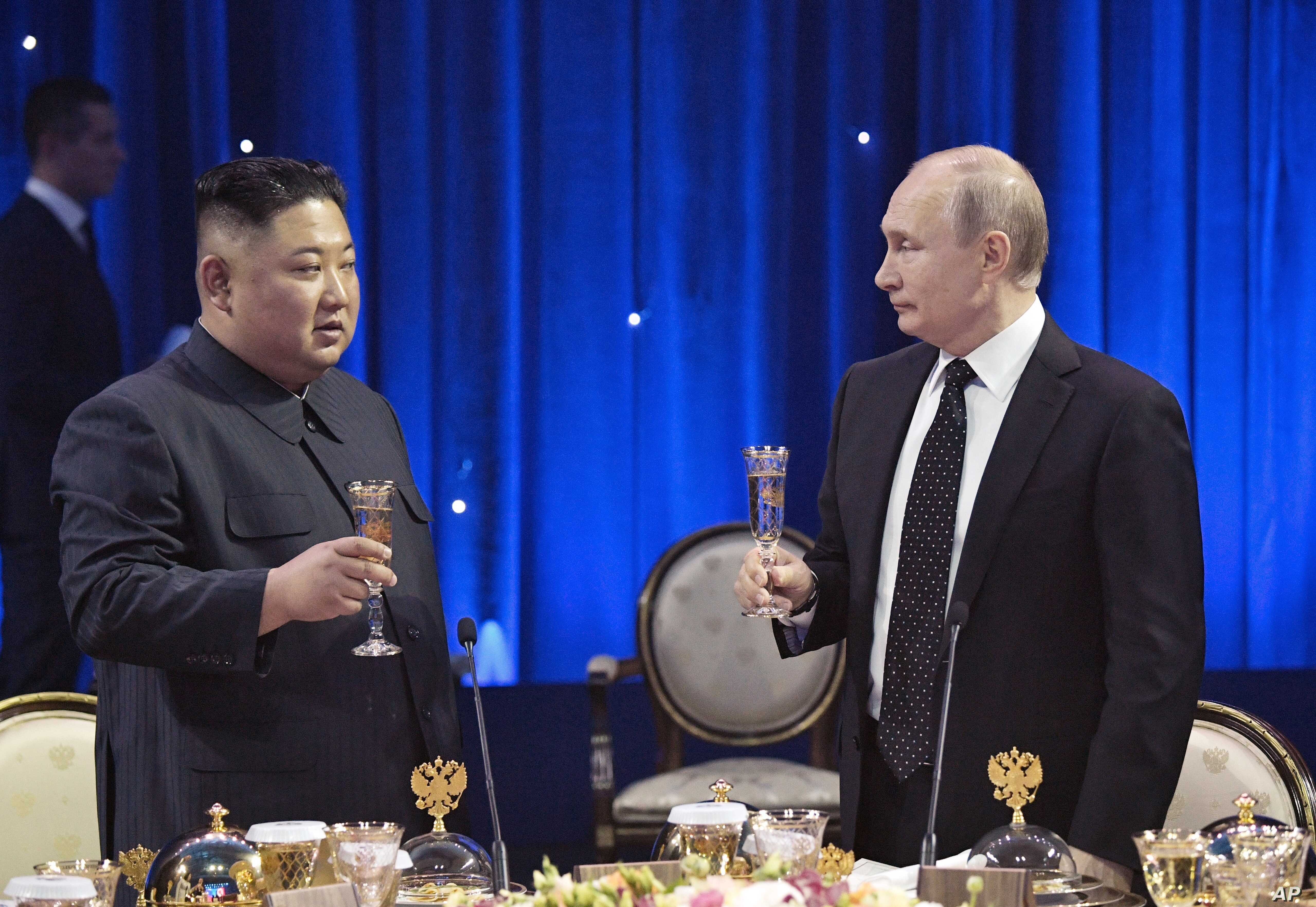 Russian President Vladimir Putin, right, toasts with North Korea's leader Kim Jong Un after their talks in Vladivostok, Russia, April 25, 2019.