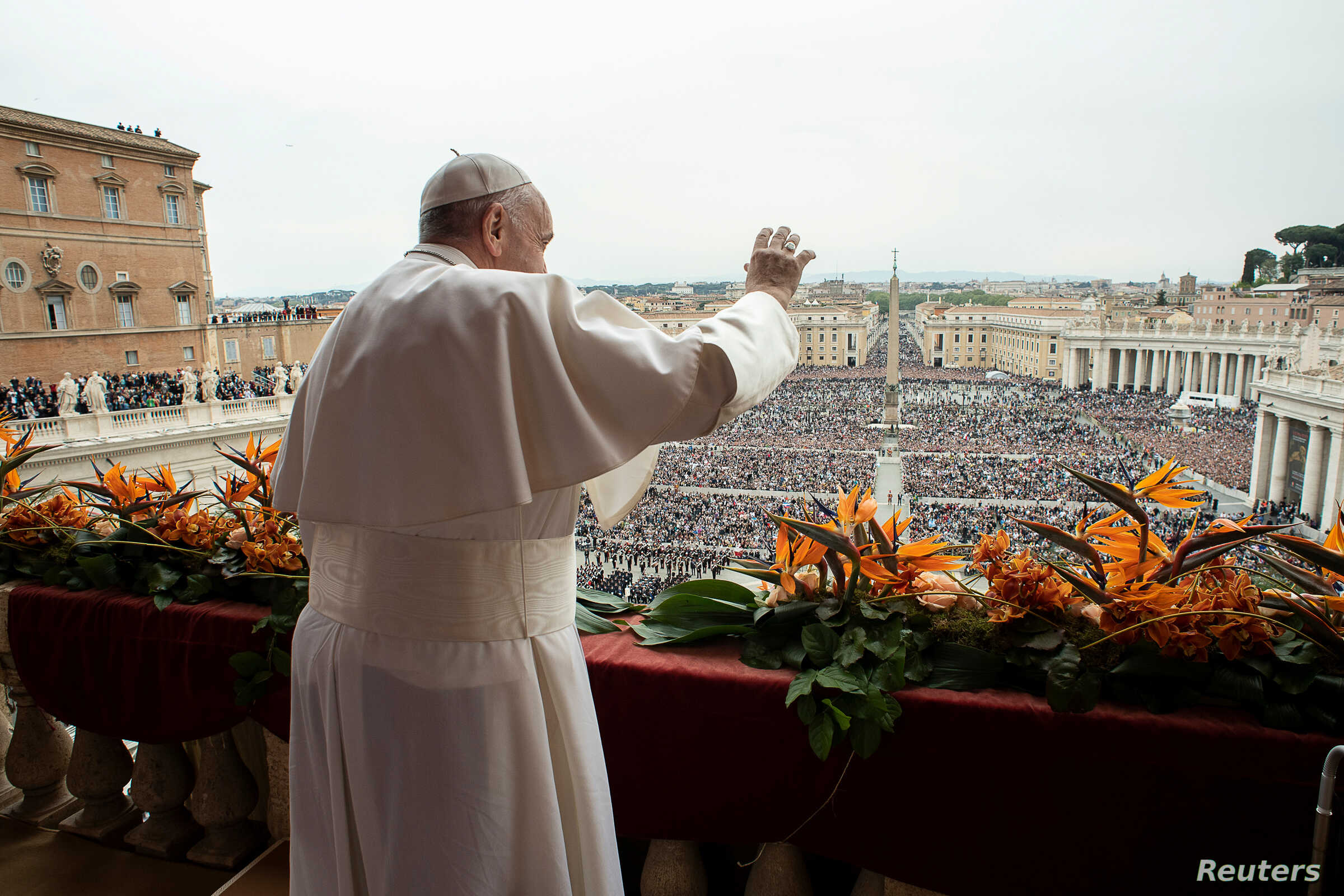 FILE - Pope Francis greets faithful from the balcony overlooking St. Peter's Square at the Vatican, April 21, 2019.