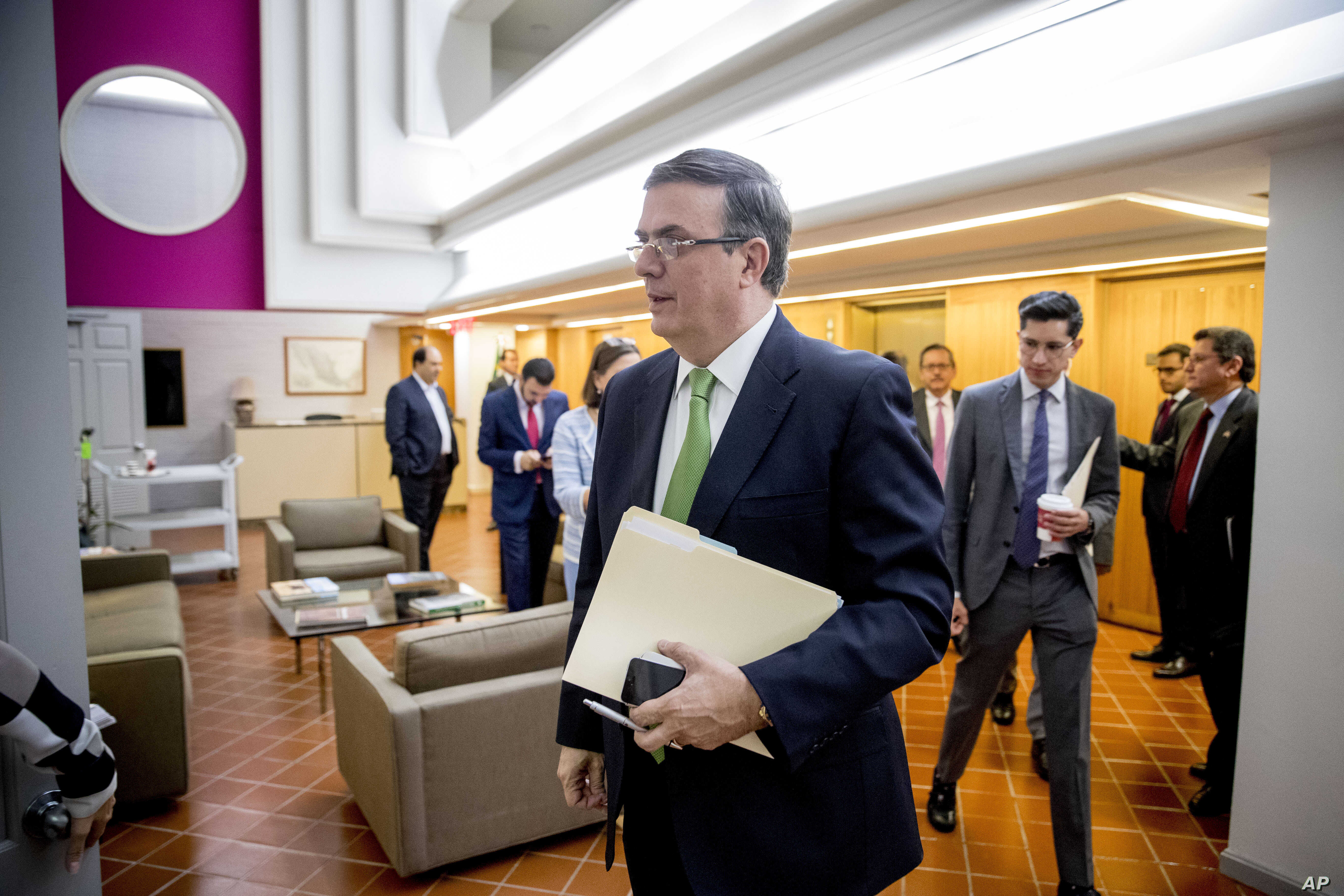 Mexican Foreign Affairs Secretary Marcelo Ebrard arrives for a news conference at the Mexican Embassy in Washington, Tuesday, June 4, 2019, as part of a Mexican delegation in Washington for talks following trade tariff threats from the Trump Administration. (AP Photo/Andrew Harnik)