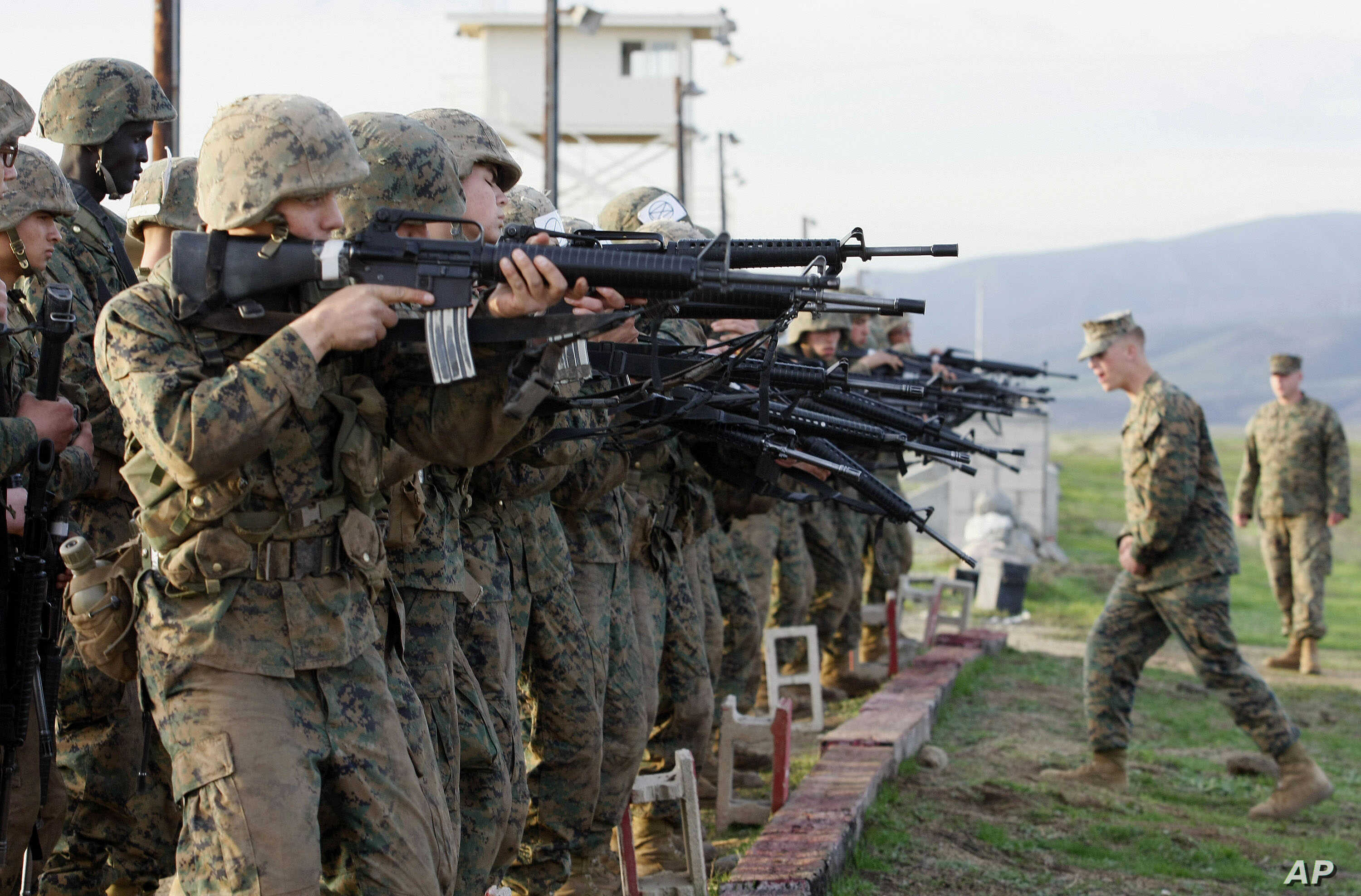FILE - Marine Corps recruits train at the Edson Firing Range in northern San Diego County, California.